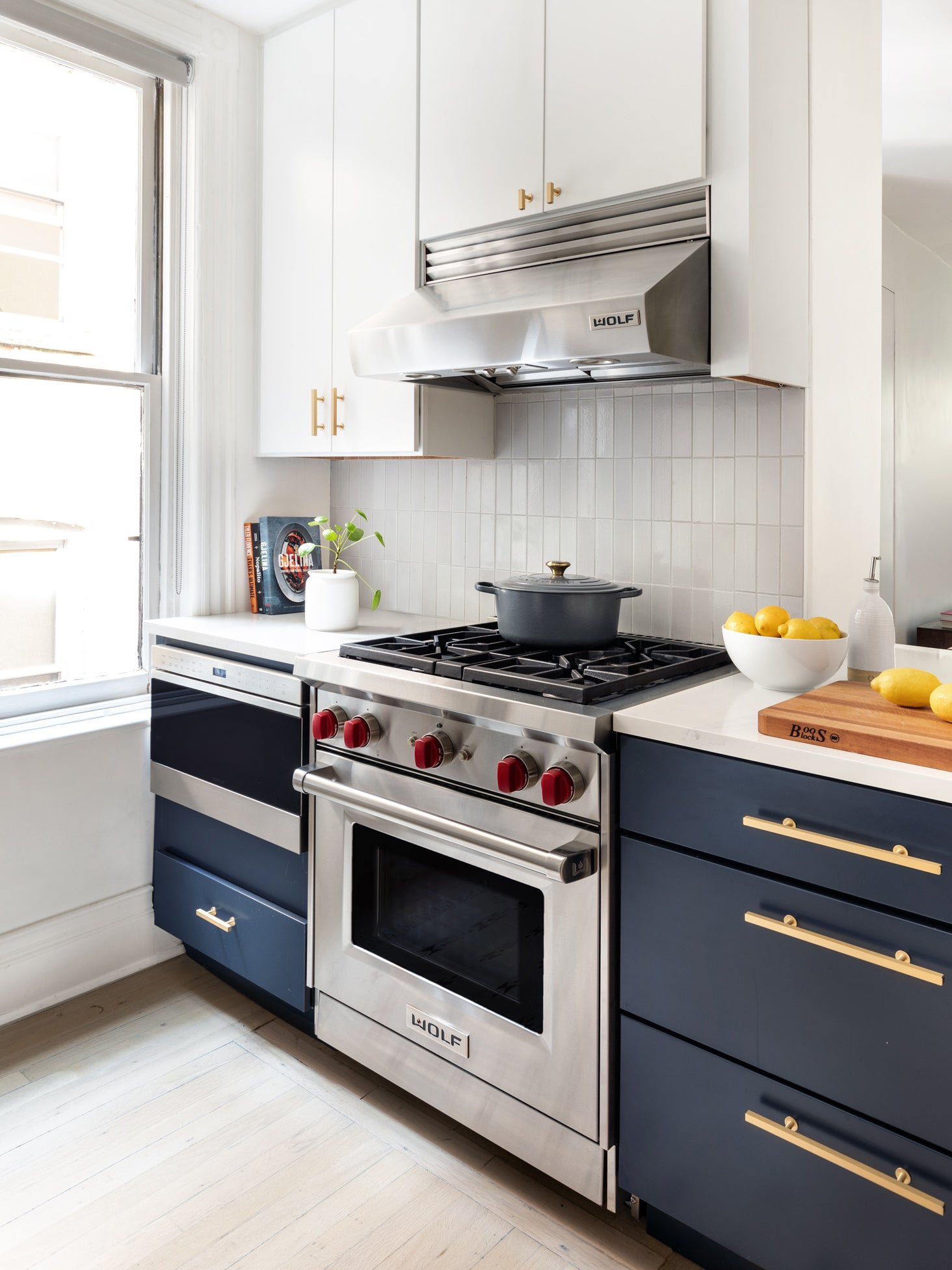 renovated kitchen with blue cabinets on the bottom and white cabinets on top