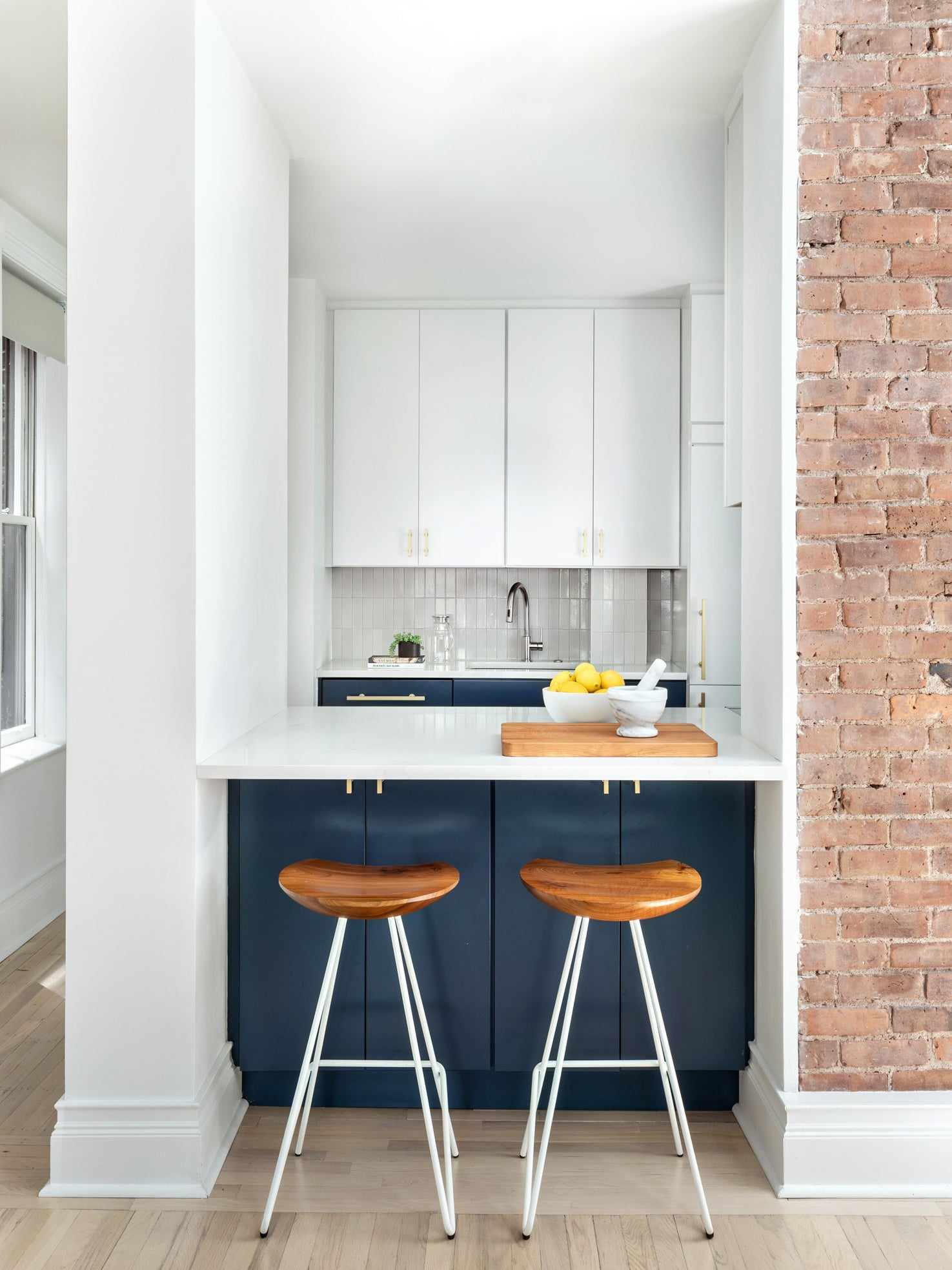 renovated kitchen with bar stools and kitchen counter