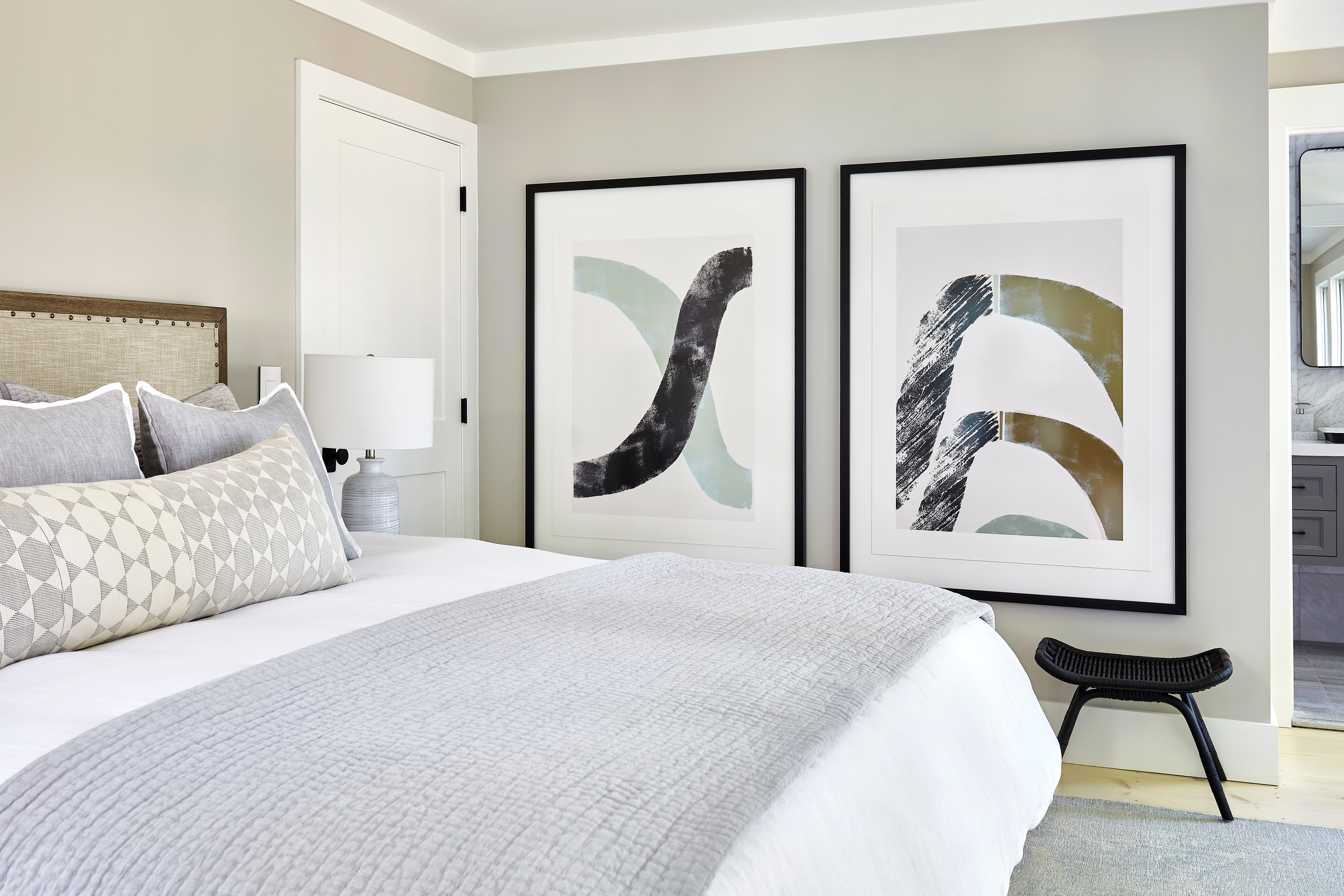Neutral toned bedroom with large scale art.