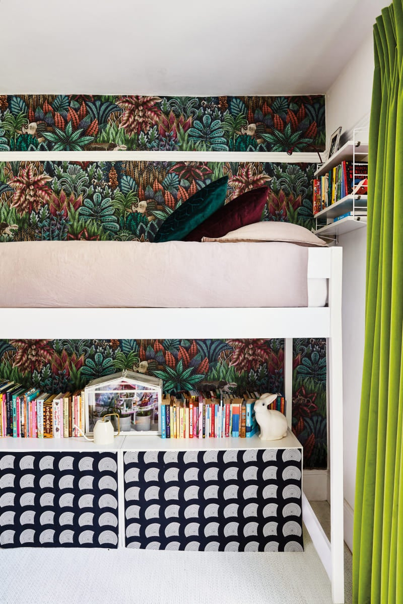 lofted kids bed with modern storage shelf below with fabric panels