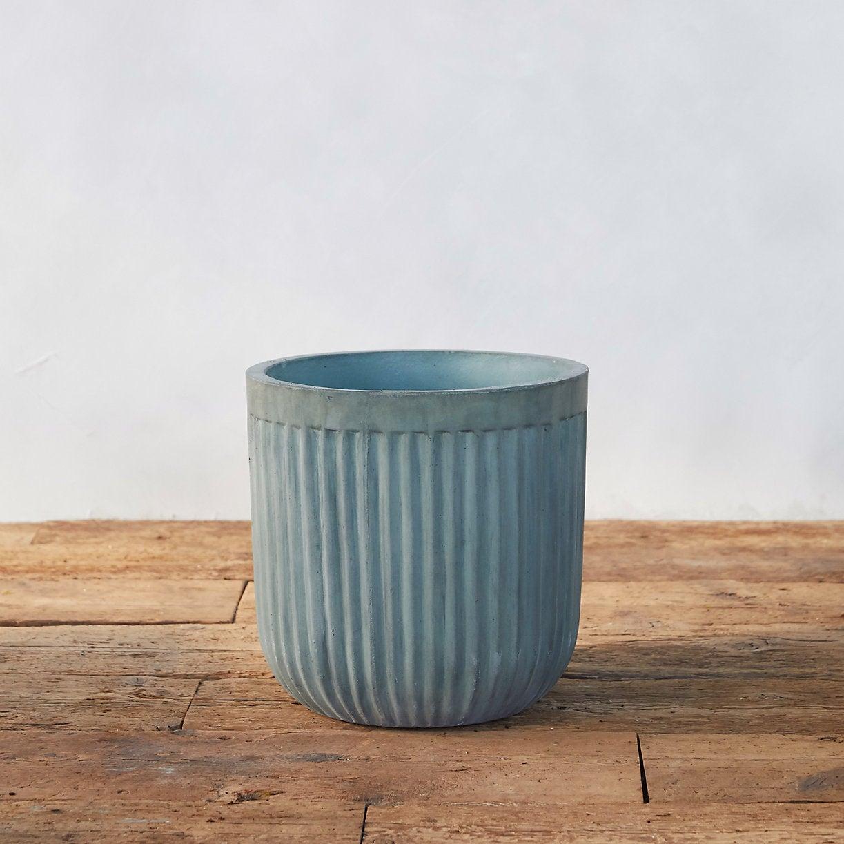 blue ribbed concrete planter