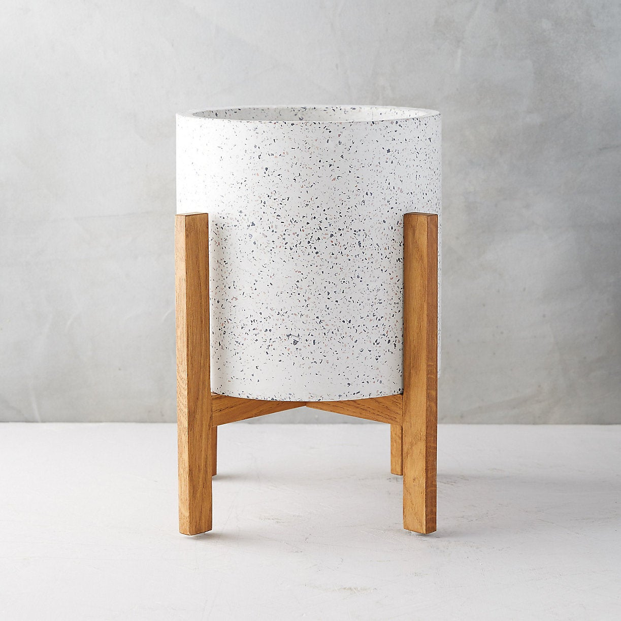 white terrazzo planter with a wood stand