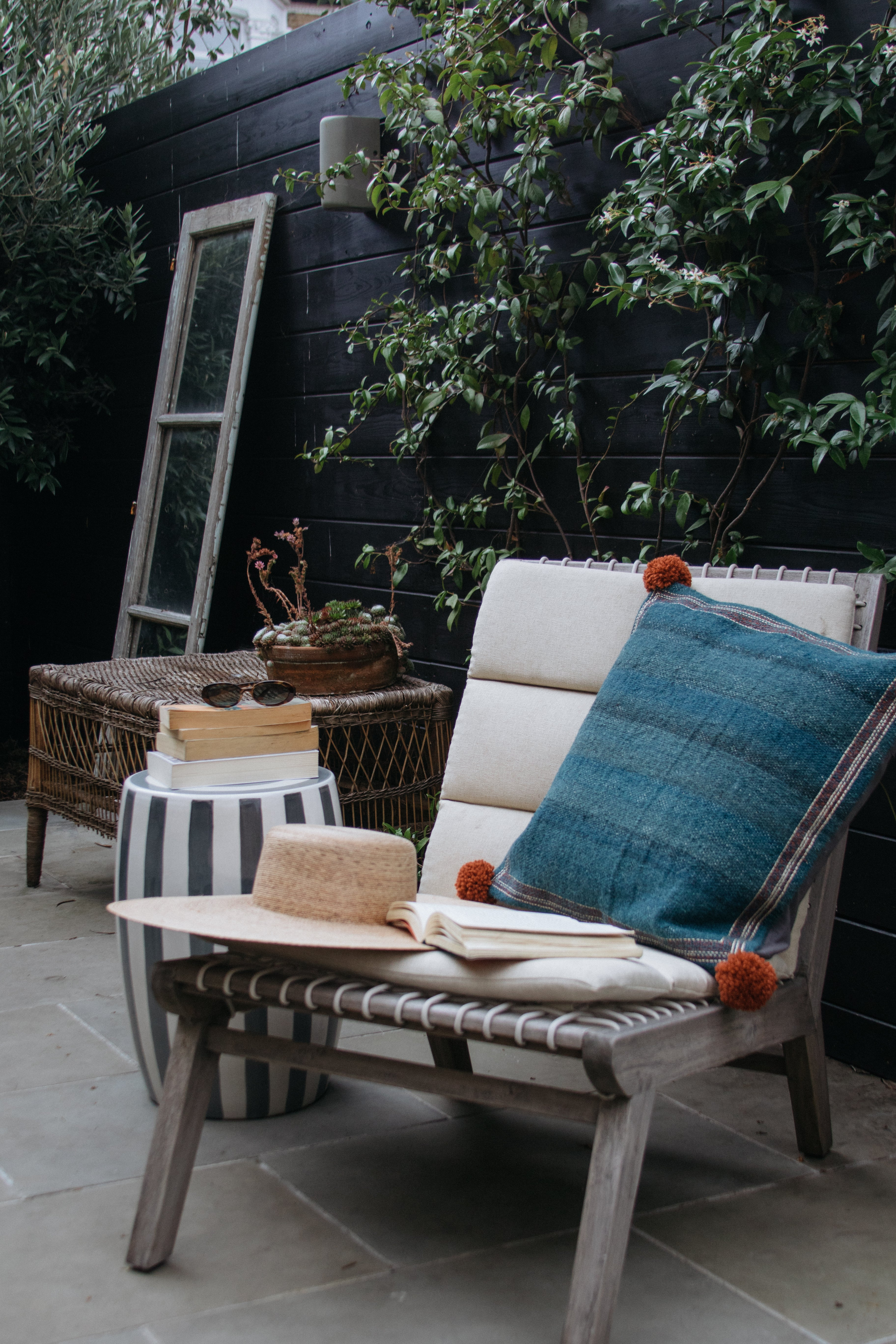 tufted outdoor chair with a denim pillow