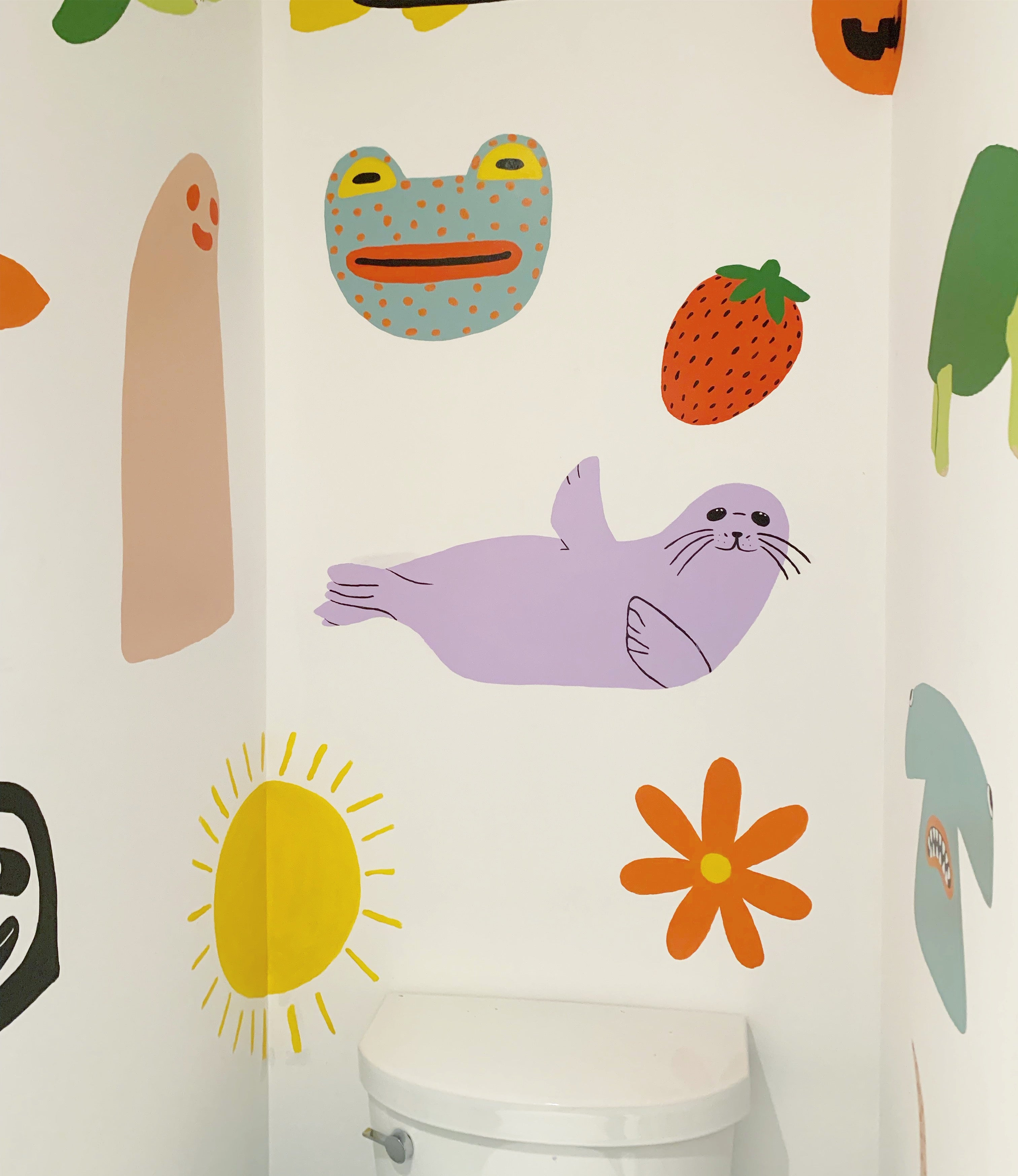 bathroom with purple seal and green frog and other shapes