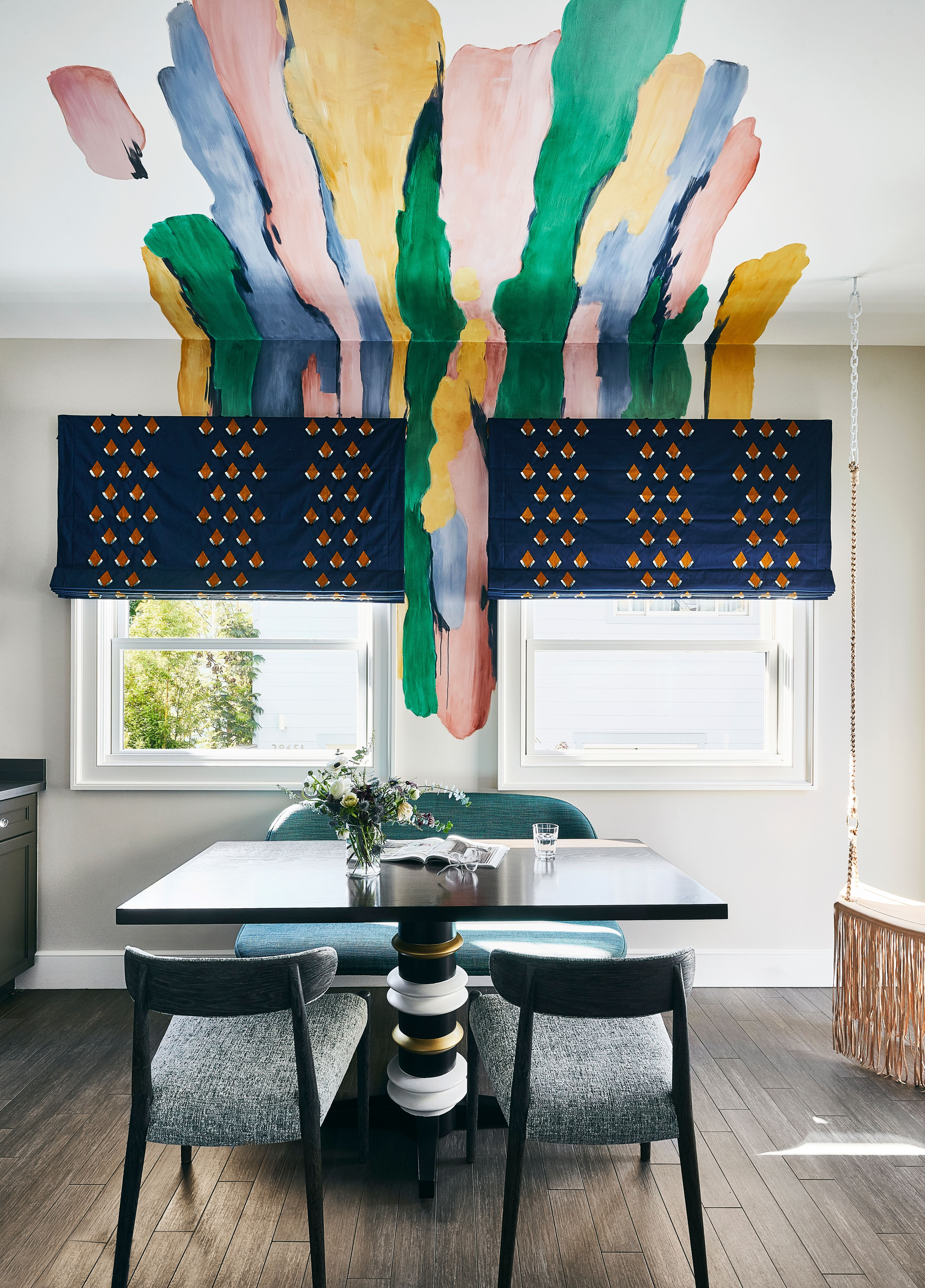 dining room with a blotch of paints going up to the ceiling