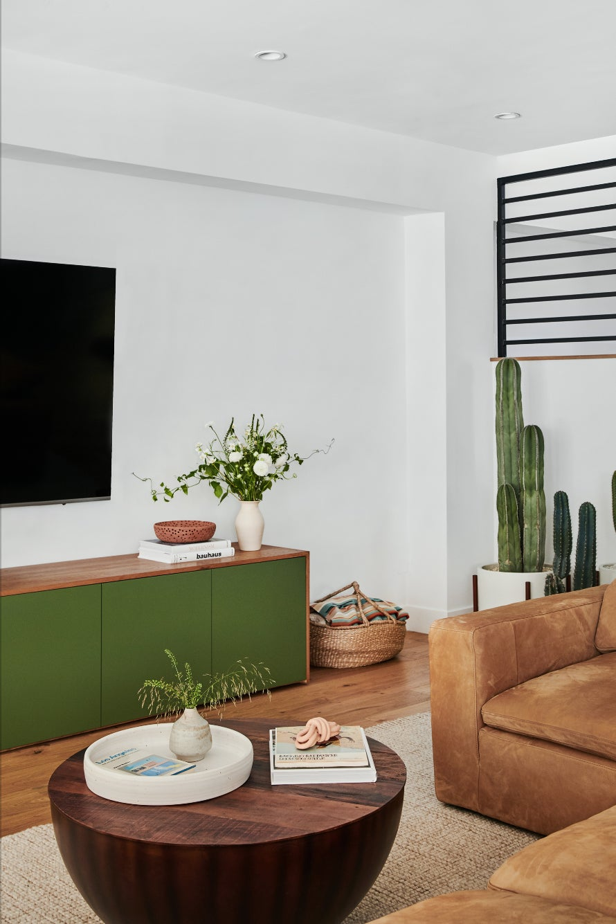 living room with a green media cabinet