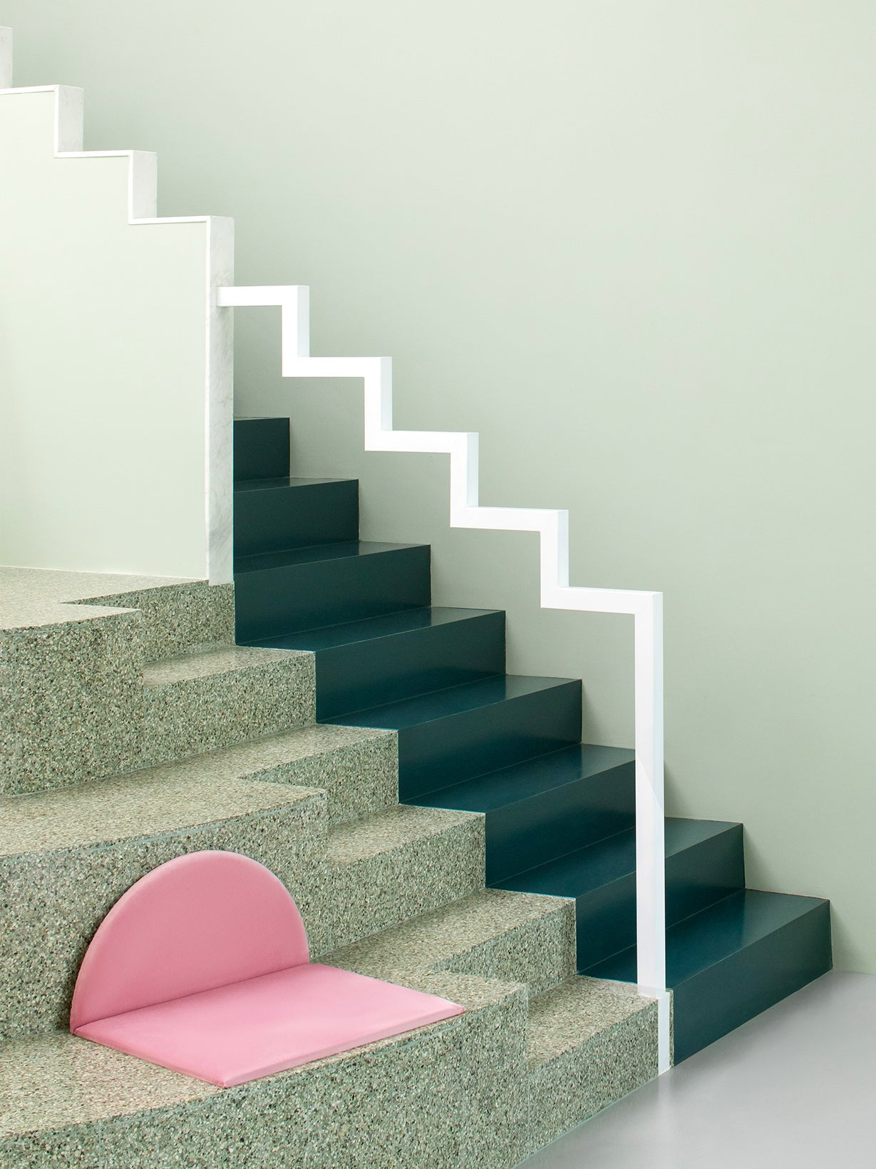 green terrazzo stairs with a white zigzag handrail