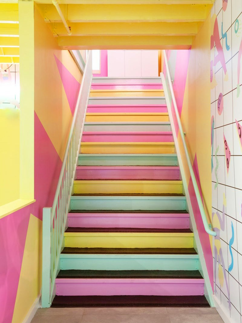 pastel pink, green, and yellow painted stairs