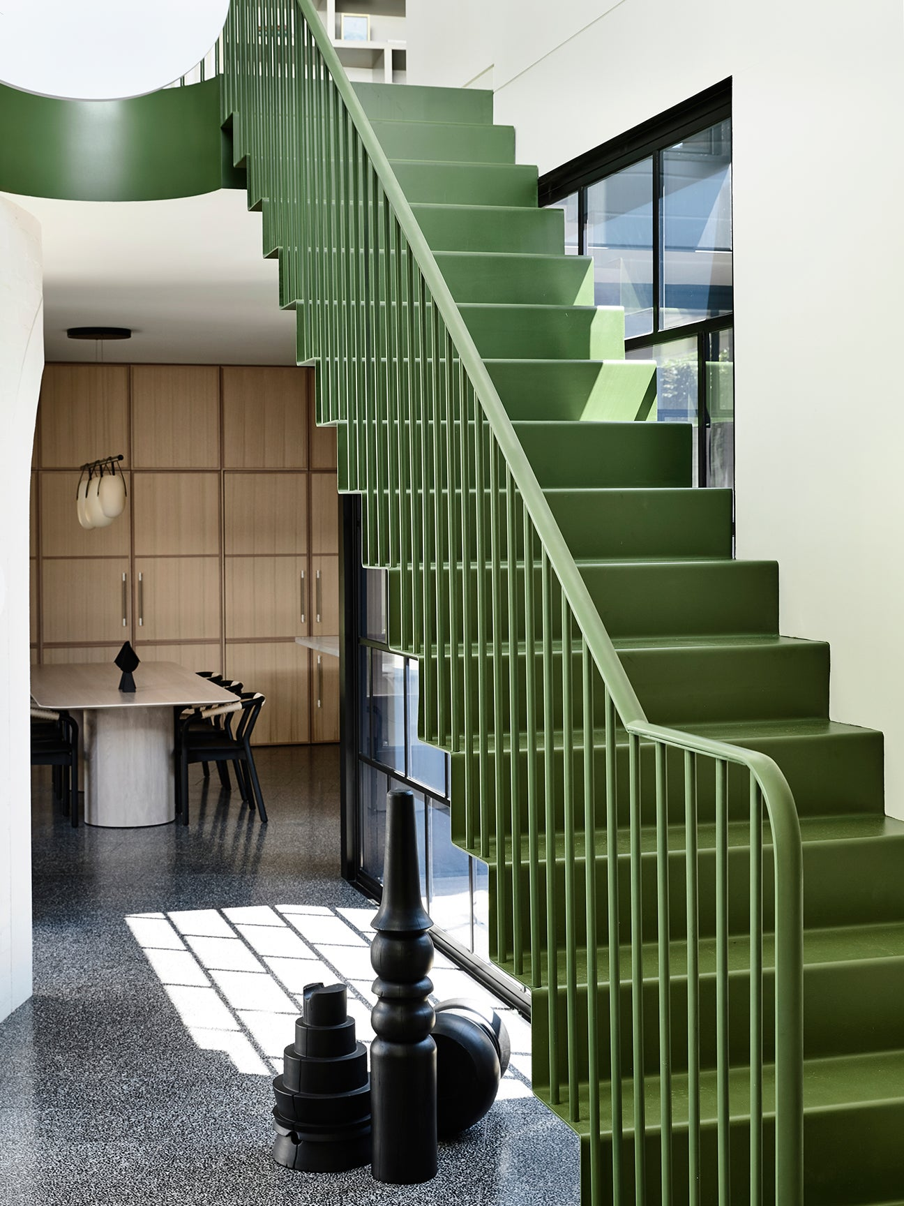 moss green staircase in a contemporary home