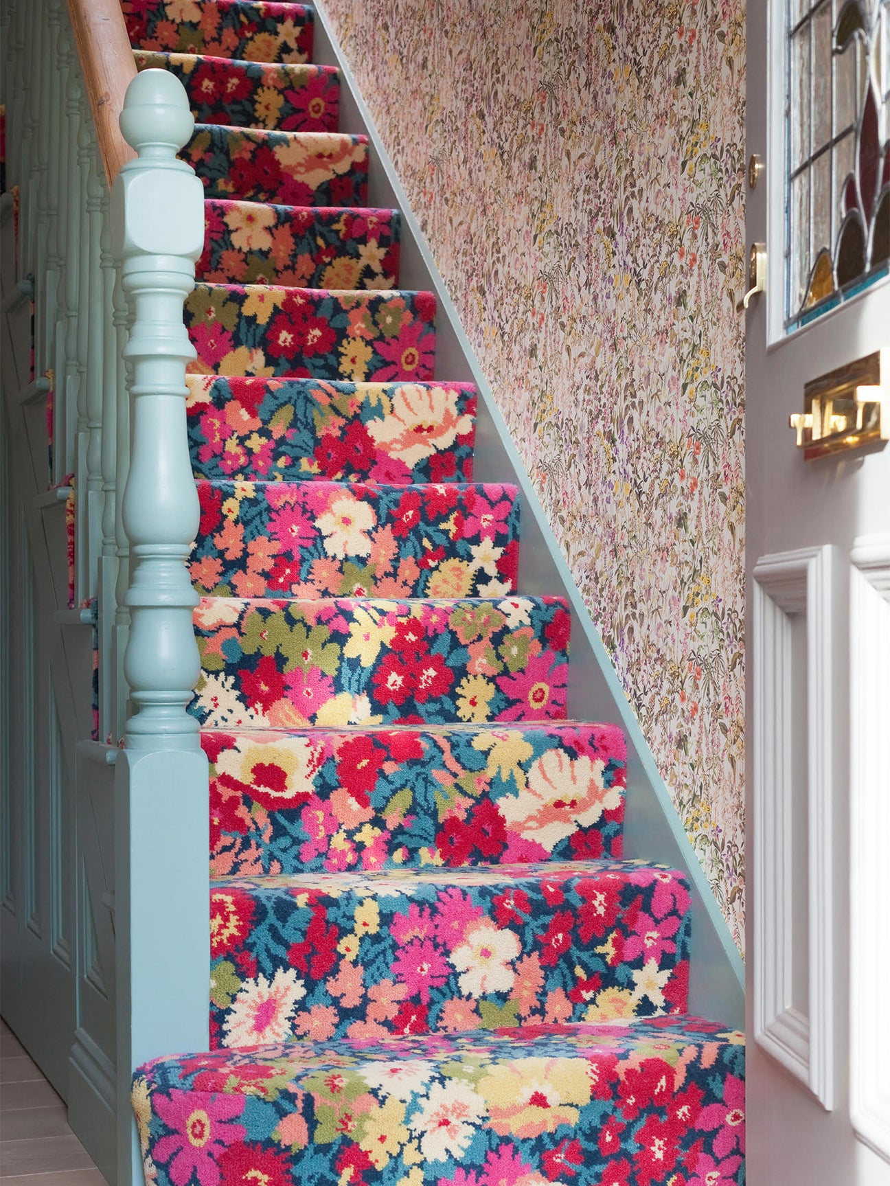 staircase carpeted with bold floral fabric