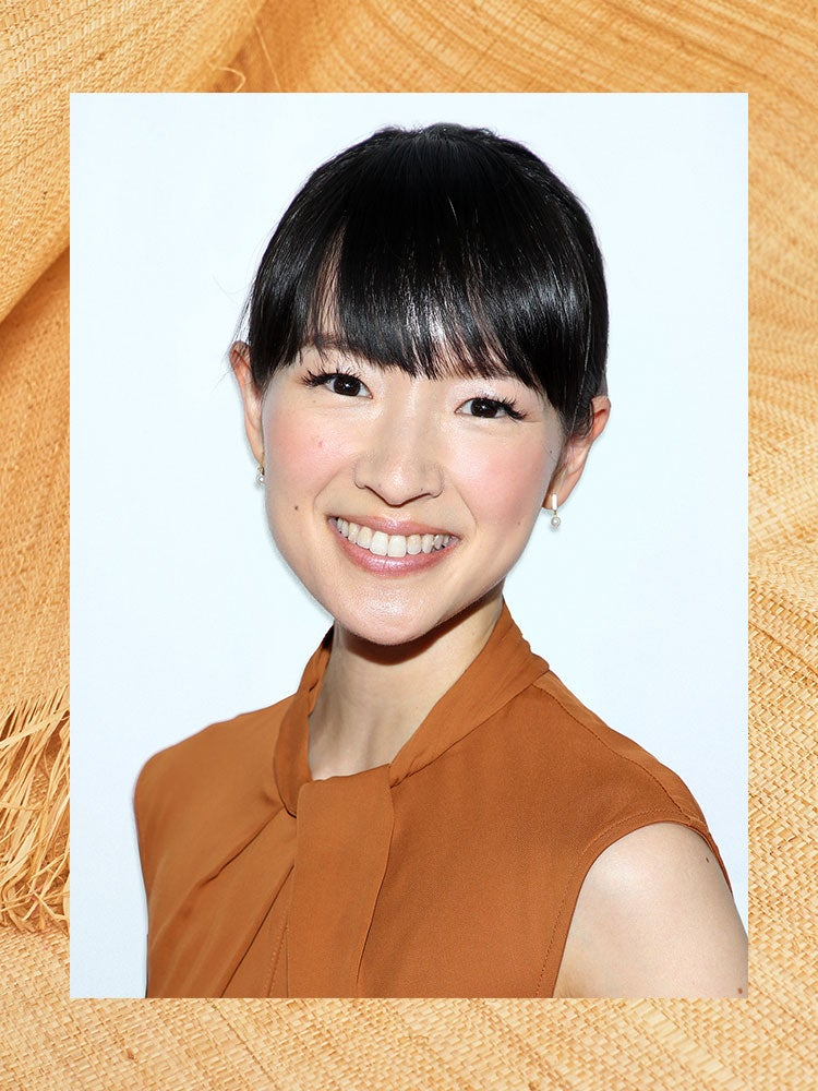 portrait of marie kondo in a brown dress against a border of wood