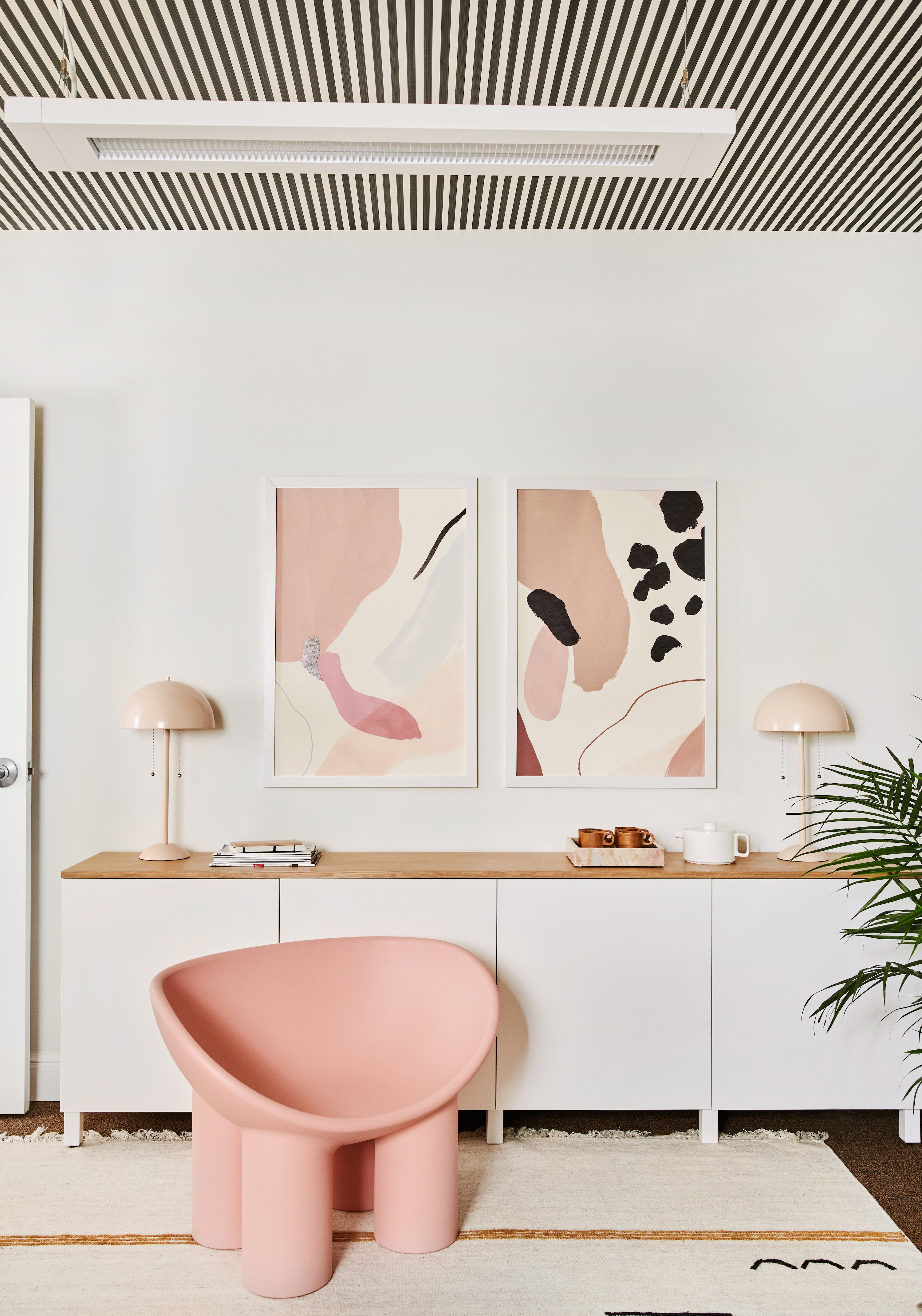 pink faye toogood chair in front of a white ikea credenza