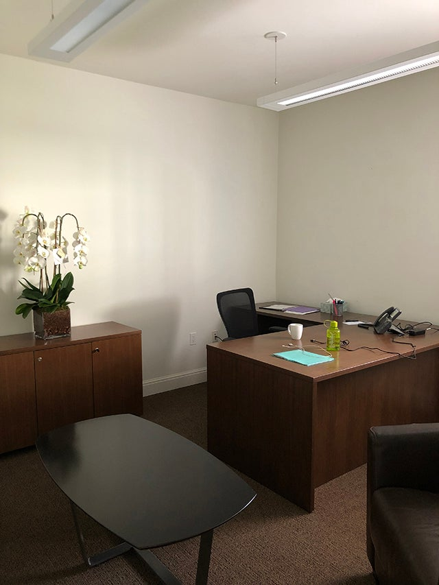 brown office furniture and a swivel chair