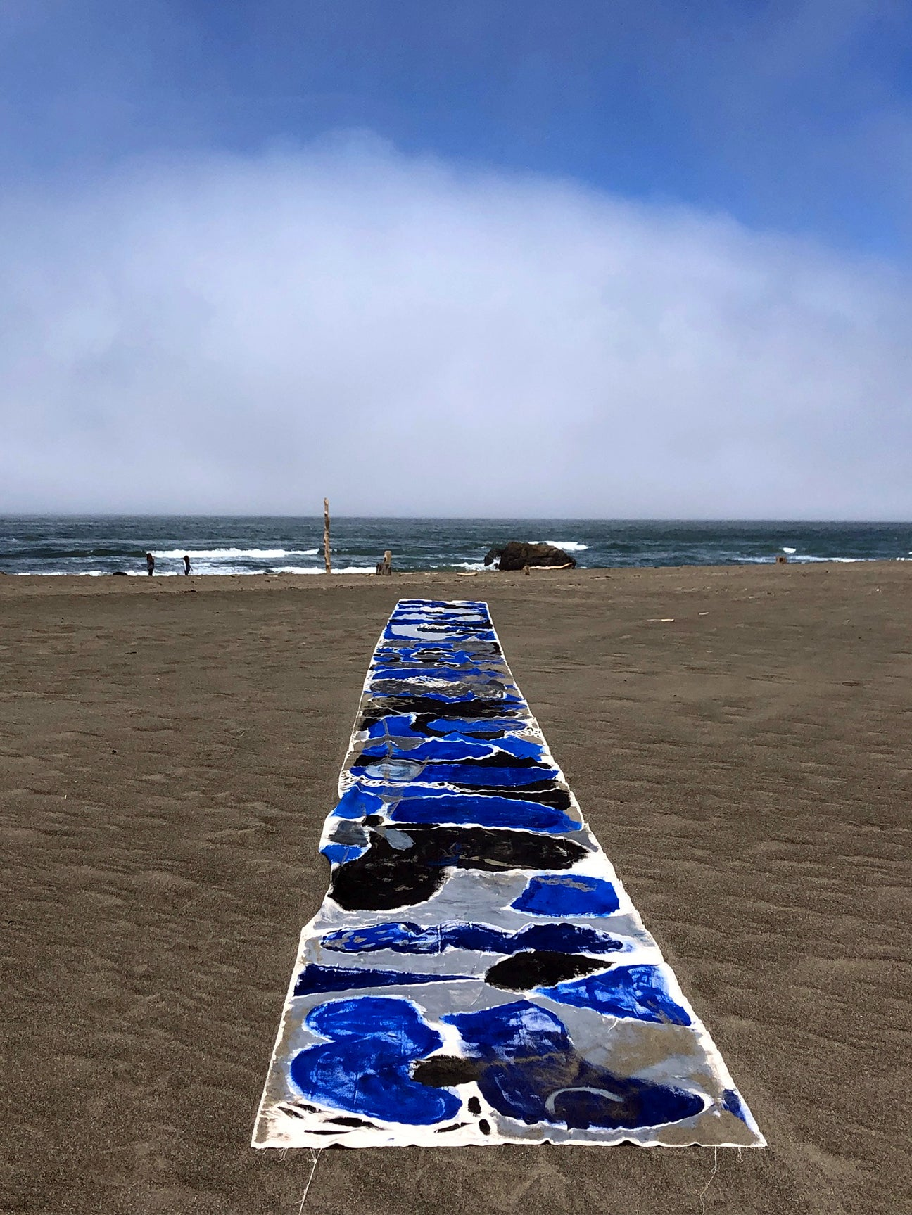 fabric strip laid out on the beach