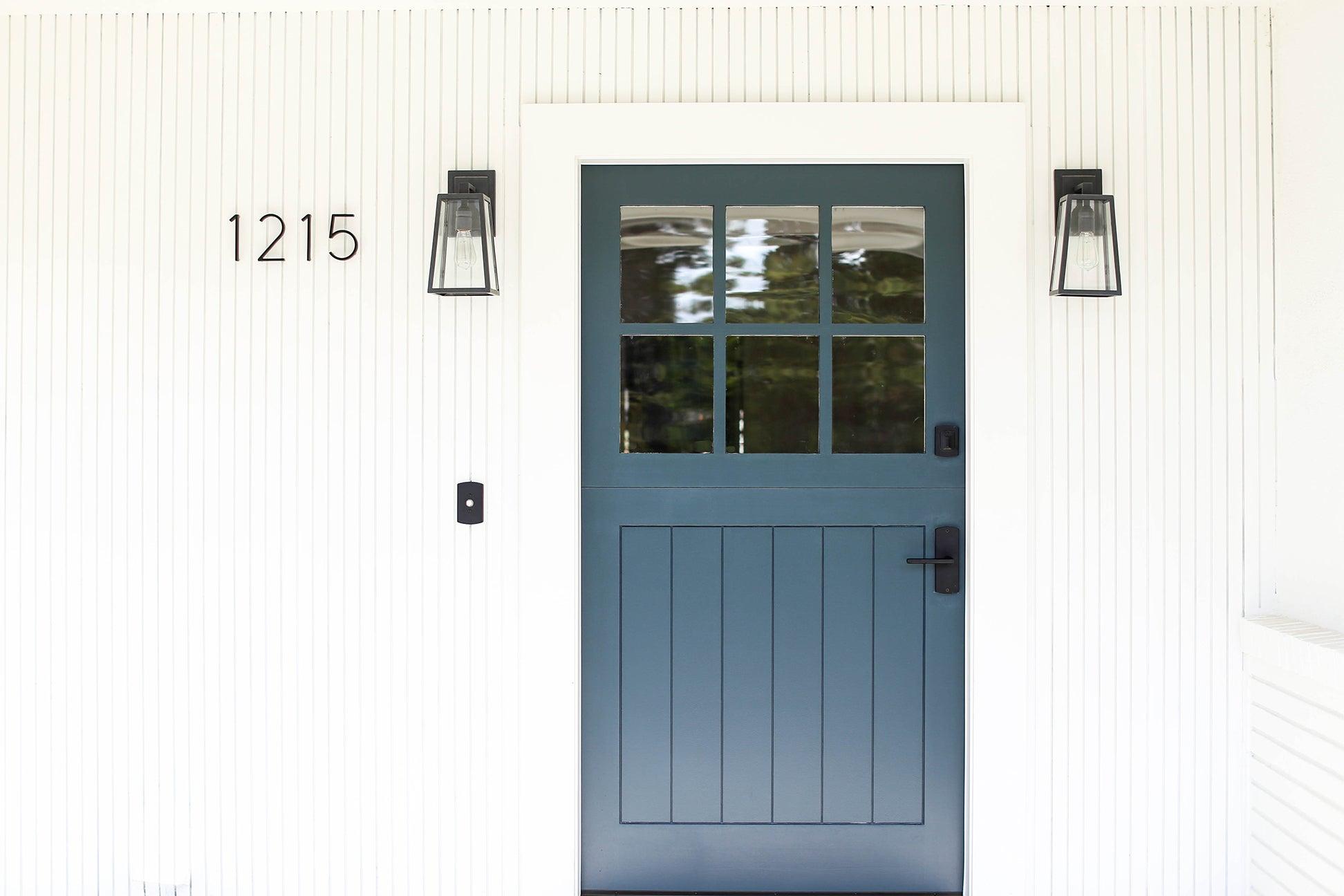 dark blue door with a white exterior