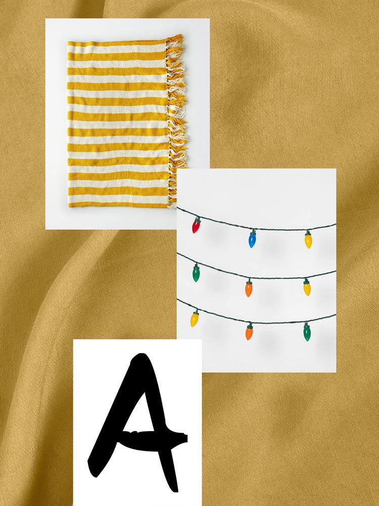 blanket, light,s and letter A on a graphic yellow backdrop