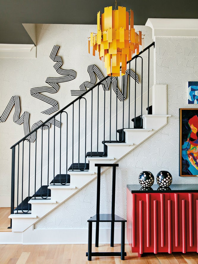 staircase-sculptural-gallery-wall-domino