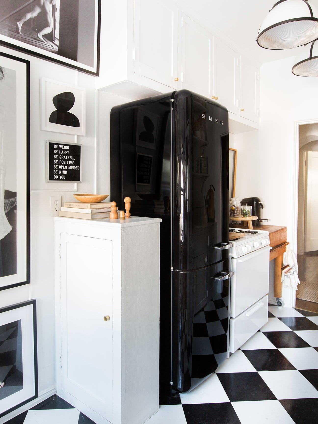 black fridge and black and white checkered floor