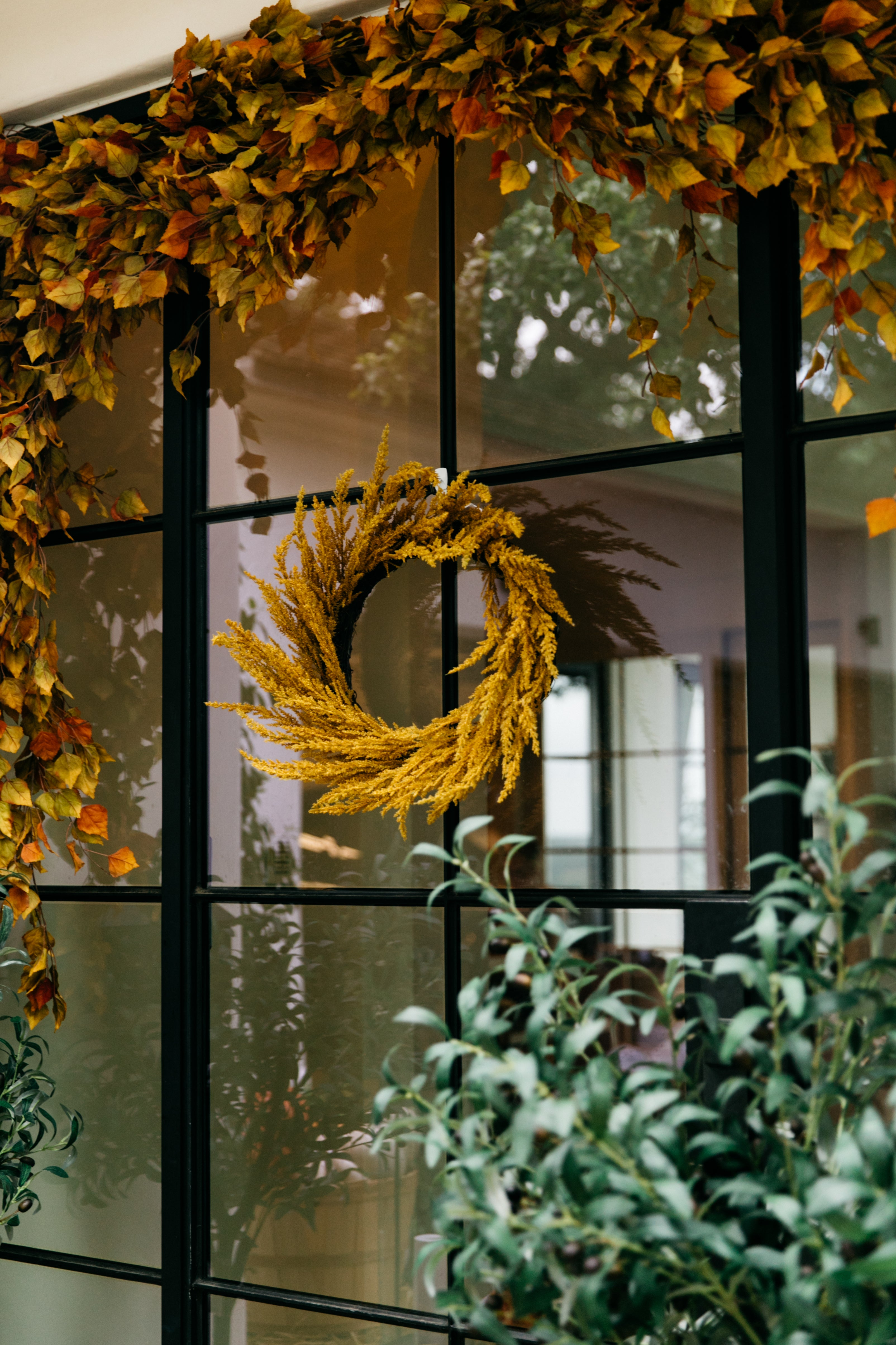 gold wreath on a glass paned front door