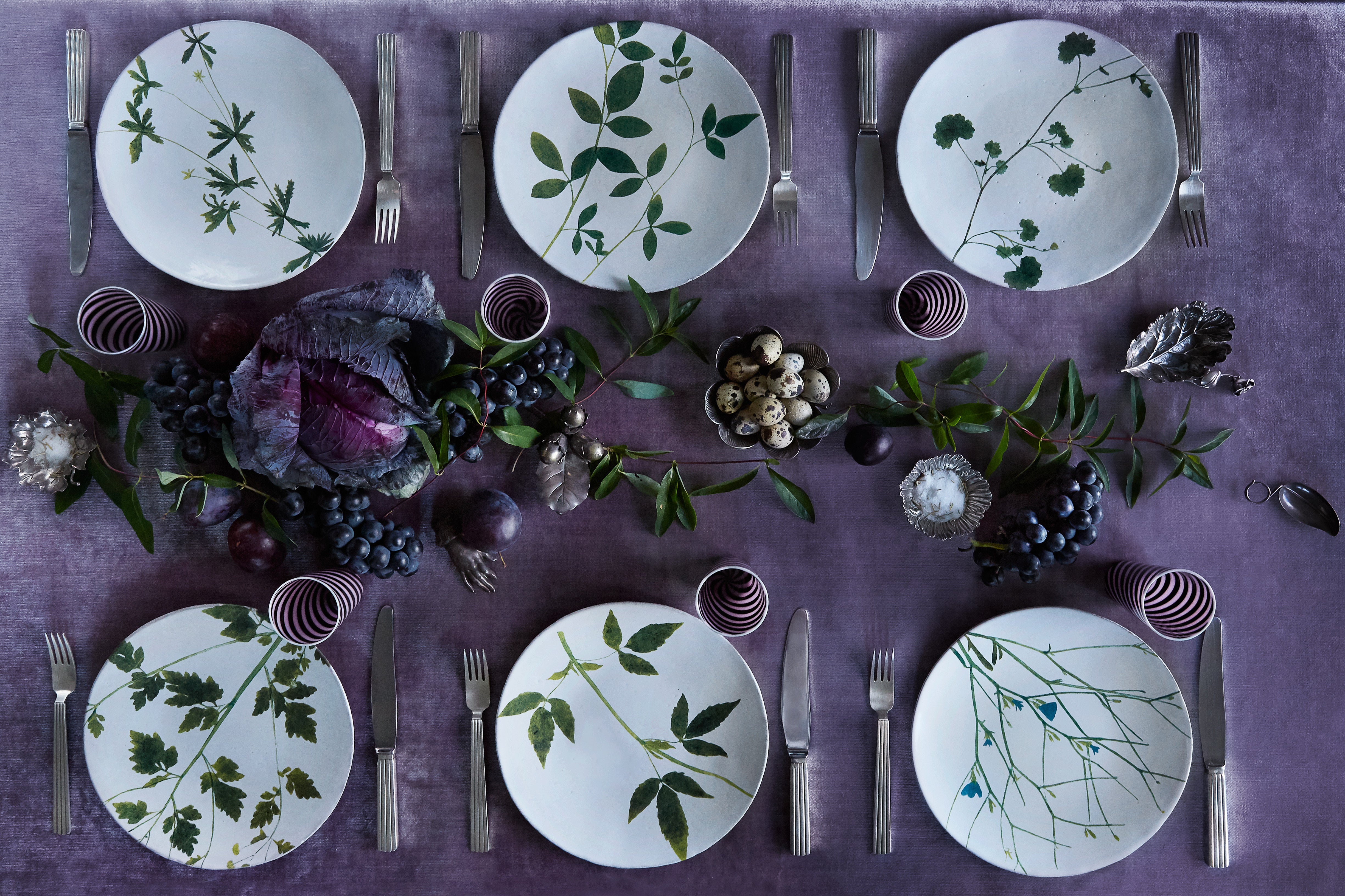 patterned floral plates on a dark purple table