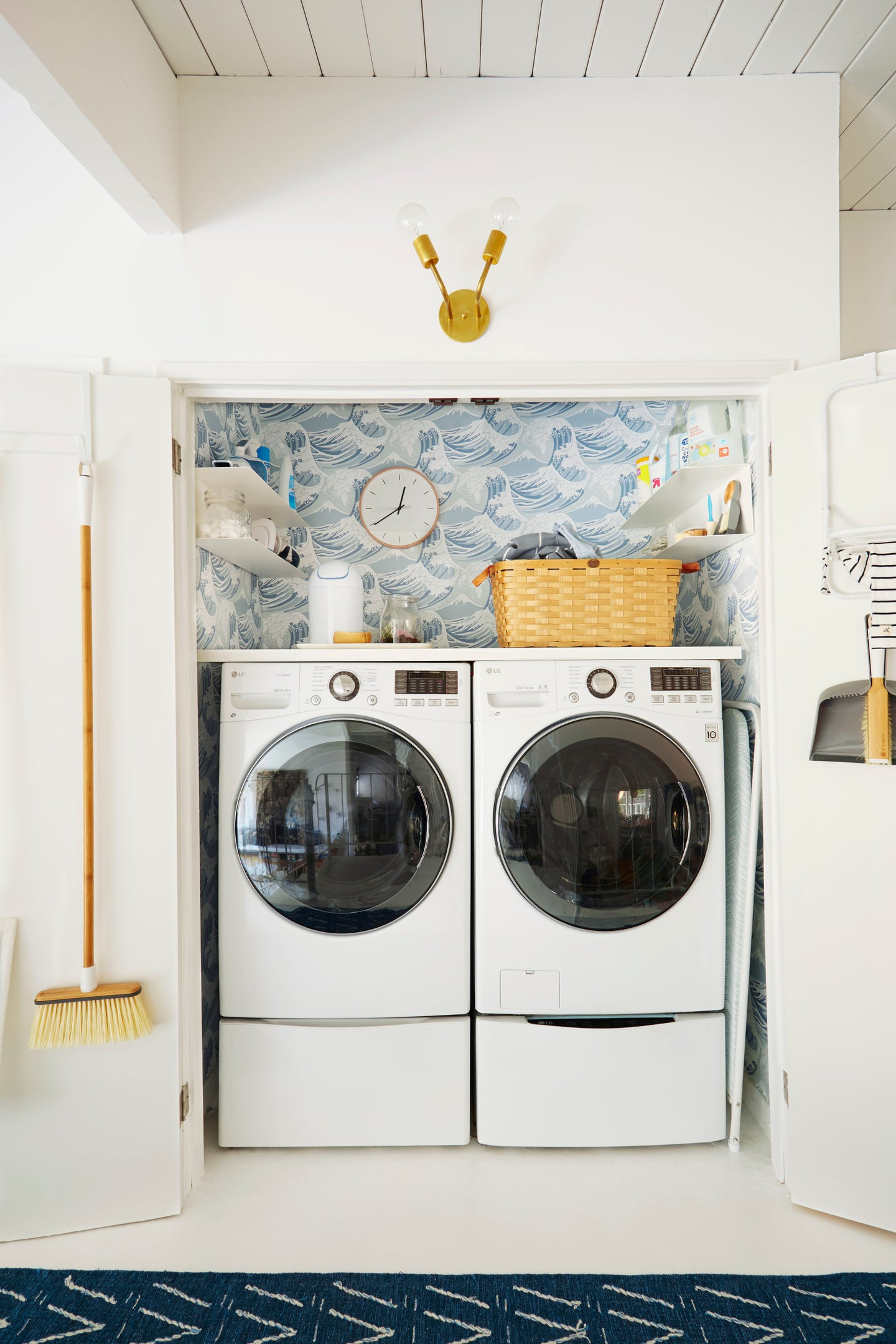laundry closet with blue ocean wallpaper