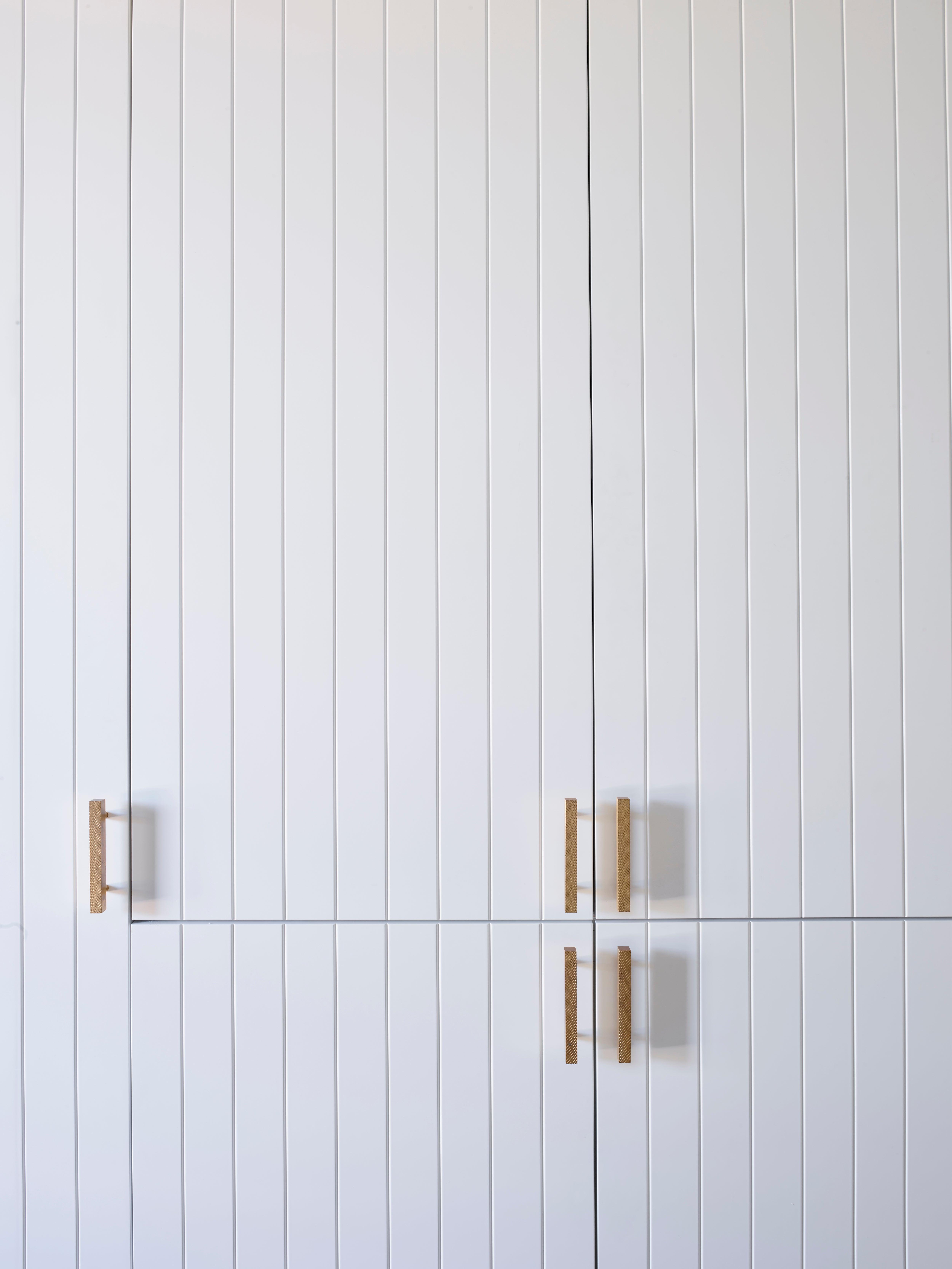slatted wood white cabinet doors