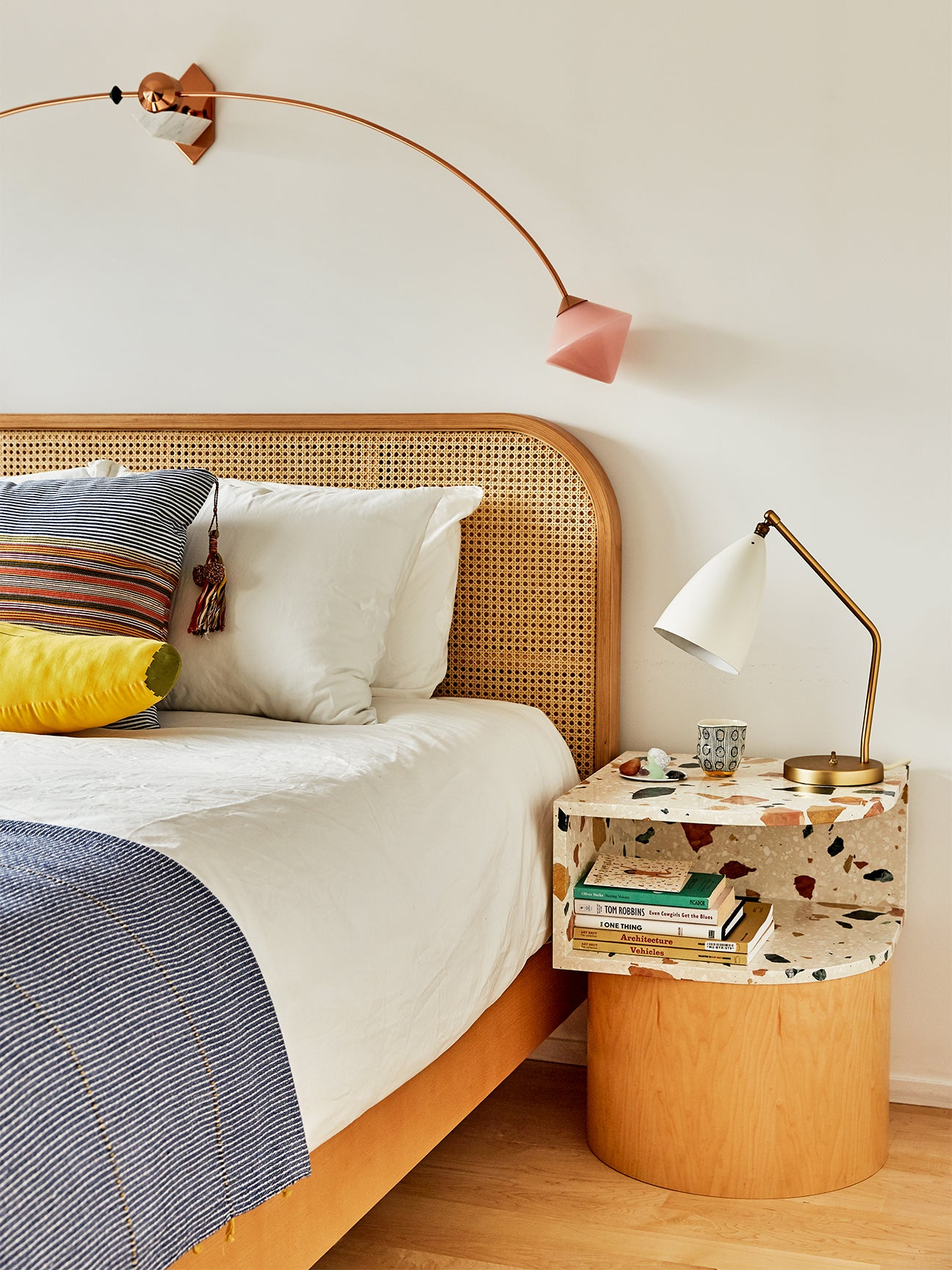 bedside tables with a shelf top made of terrazzo