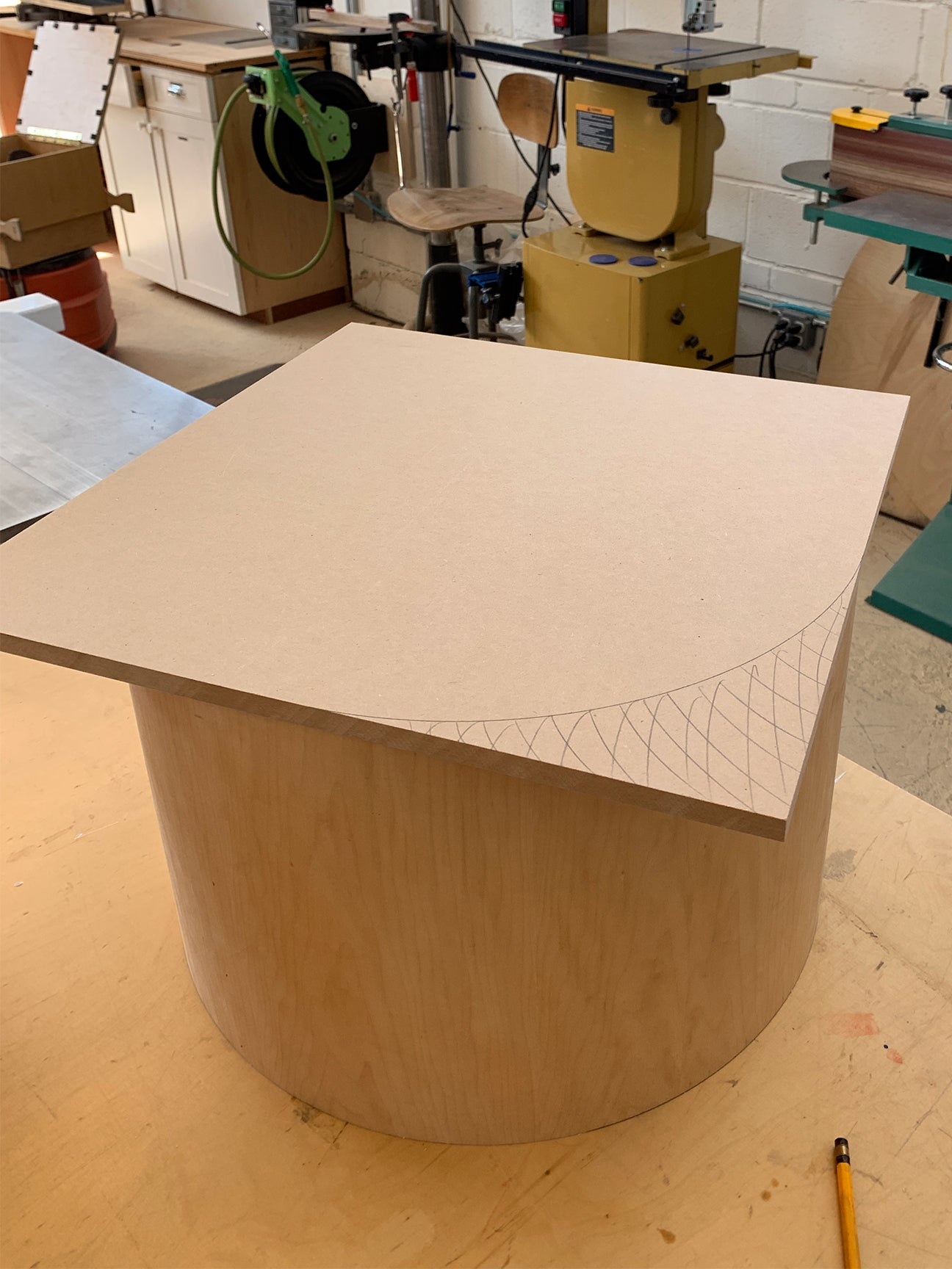 wood top and base sitting in a workshop