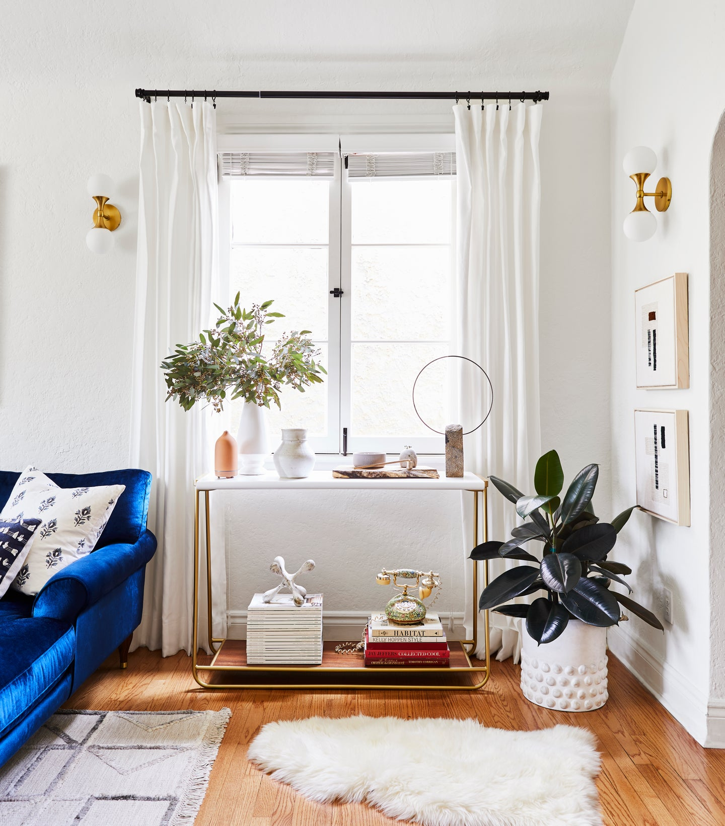 bright airy living room with sheepskin rug and white barcart