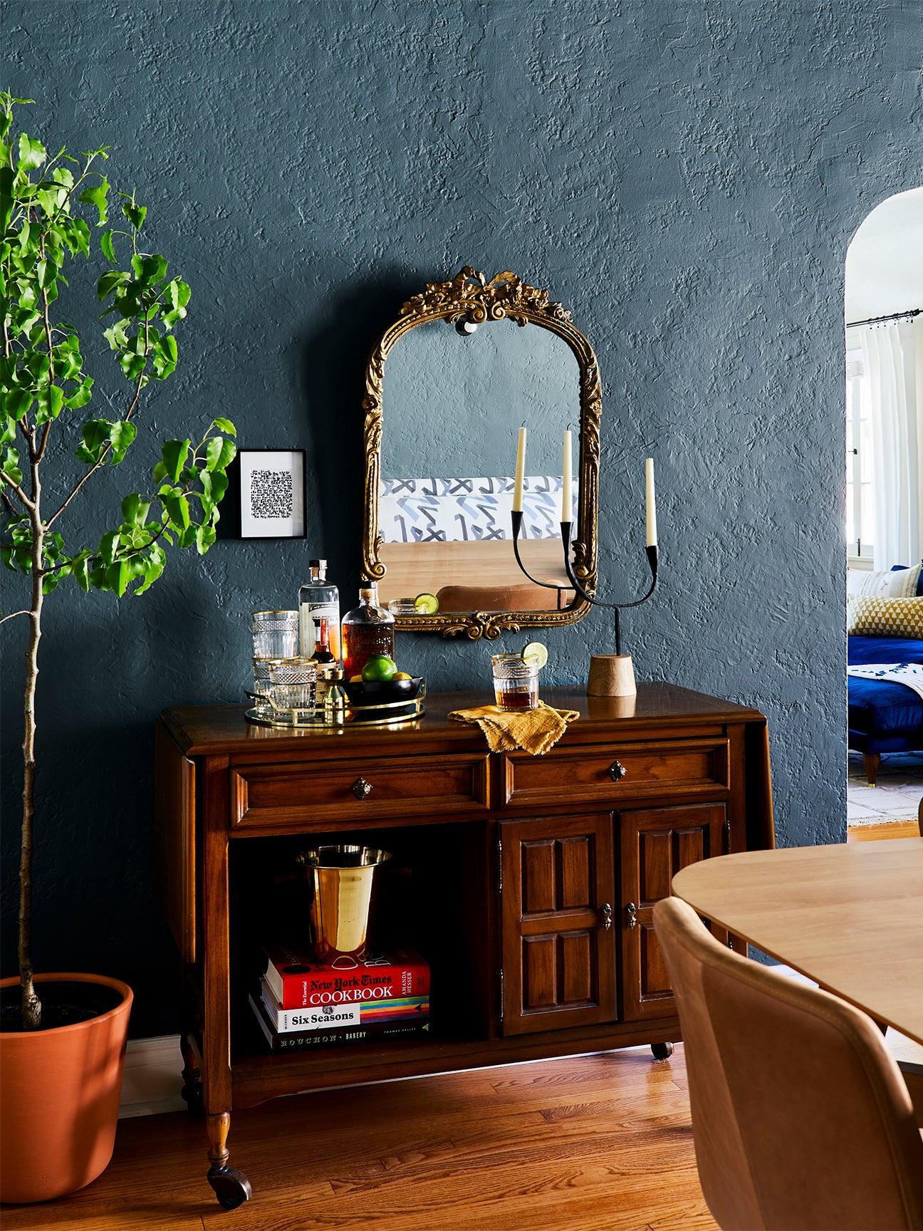 dark blue dining room with vintage wood bar