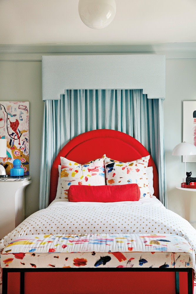 blue canopy over a red bed