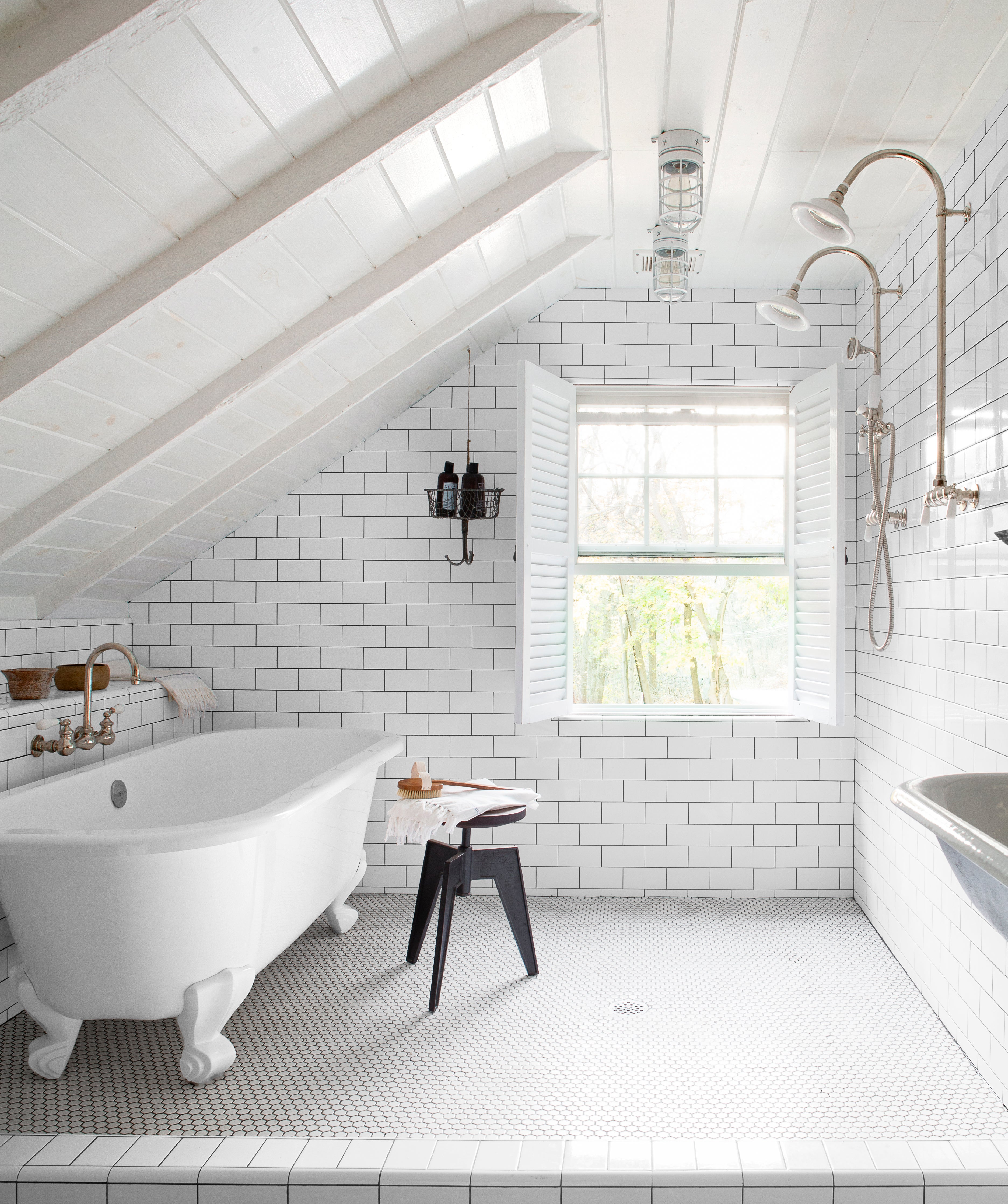slanted roof with a tub and shower