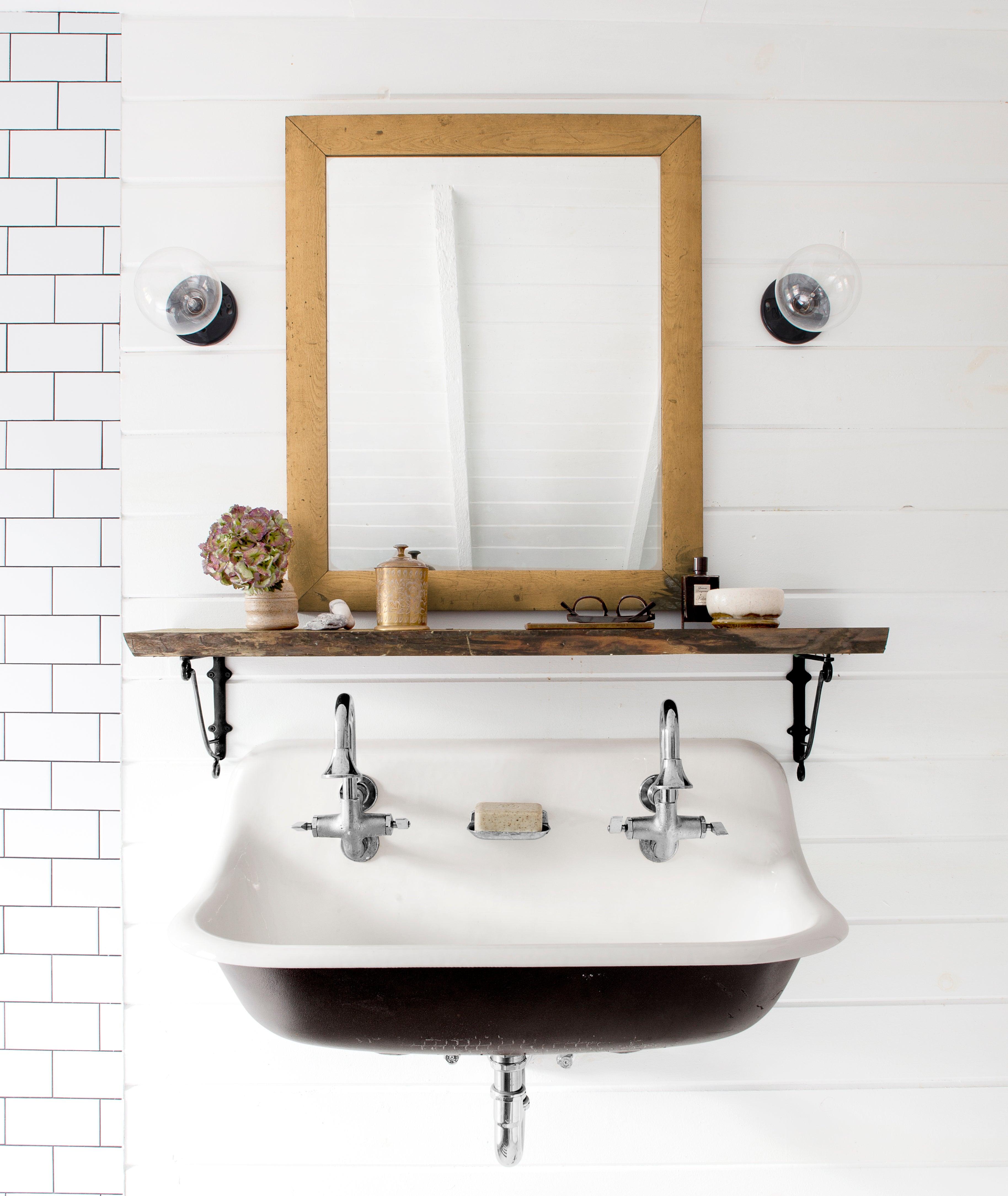 close up of a double faucet farmhouse sink