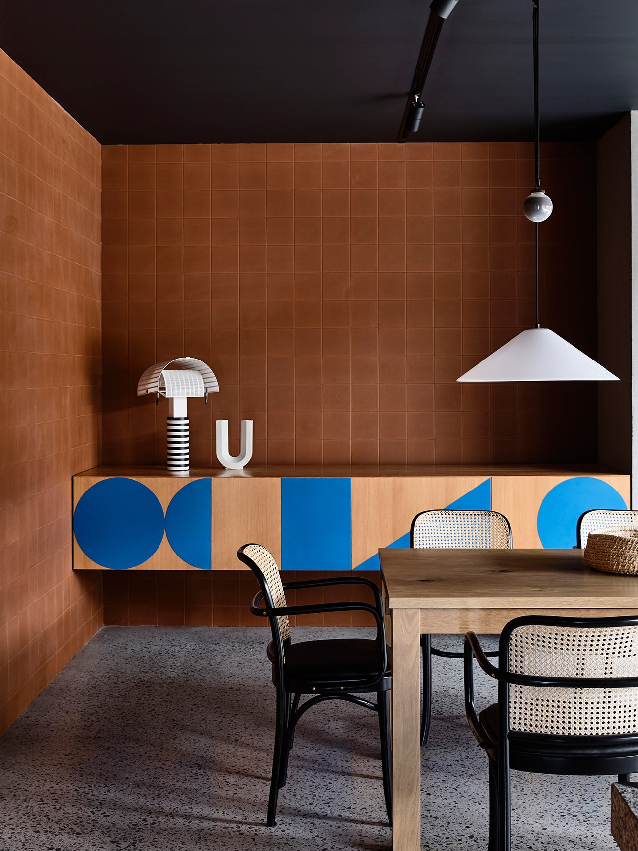 brown tiled walls in a dining room