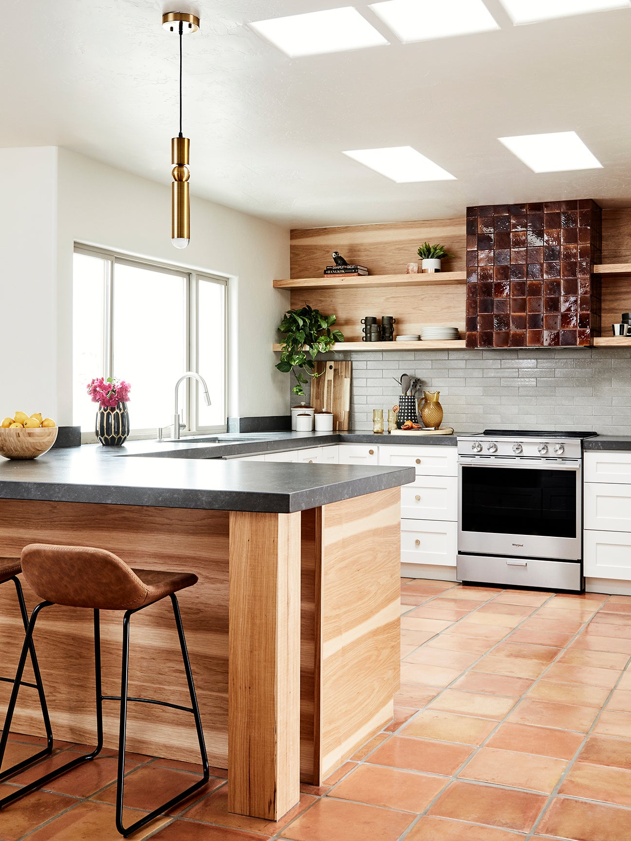 wood kitchen with a brown tiled range hood