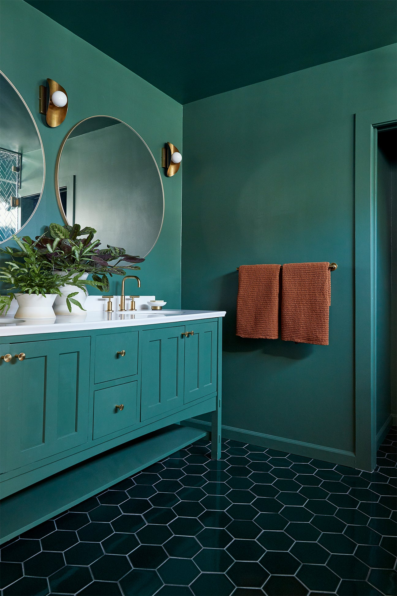 round mirror and a green vanity