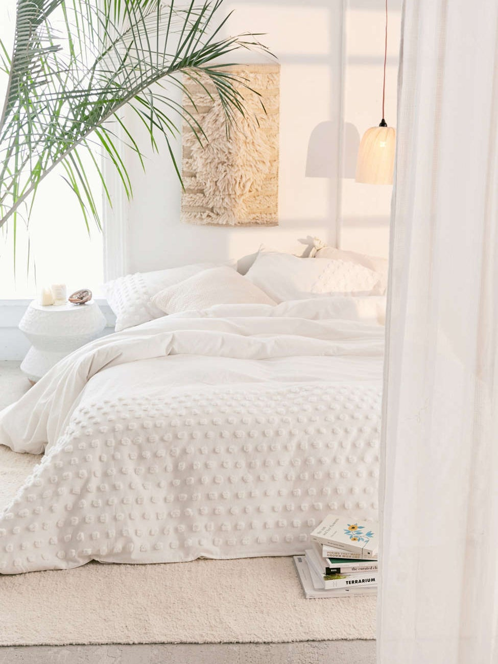 White bedspread on a mattress on the floor