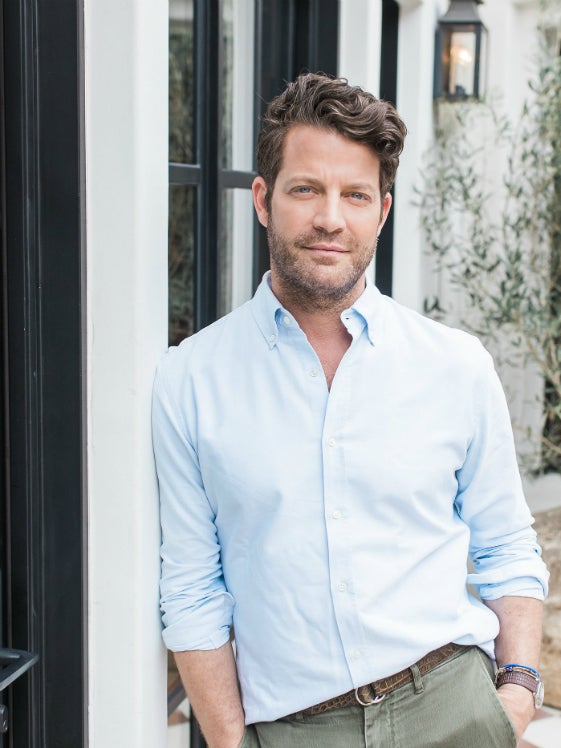 nate berkus leaning against a wall