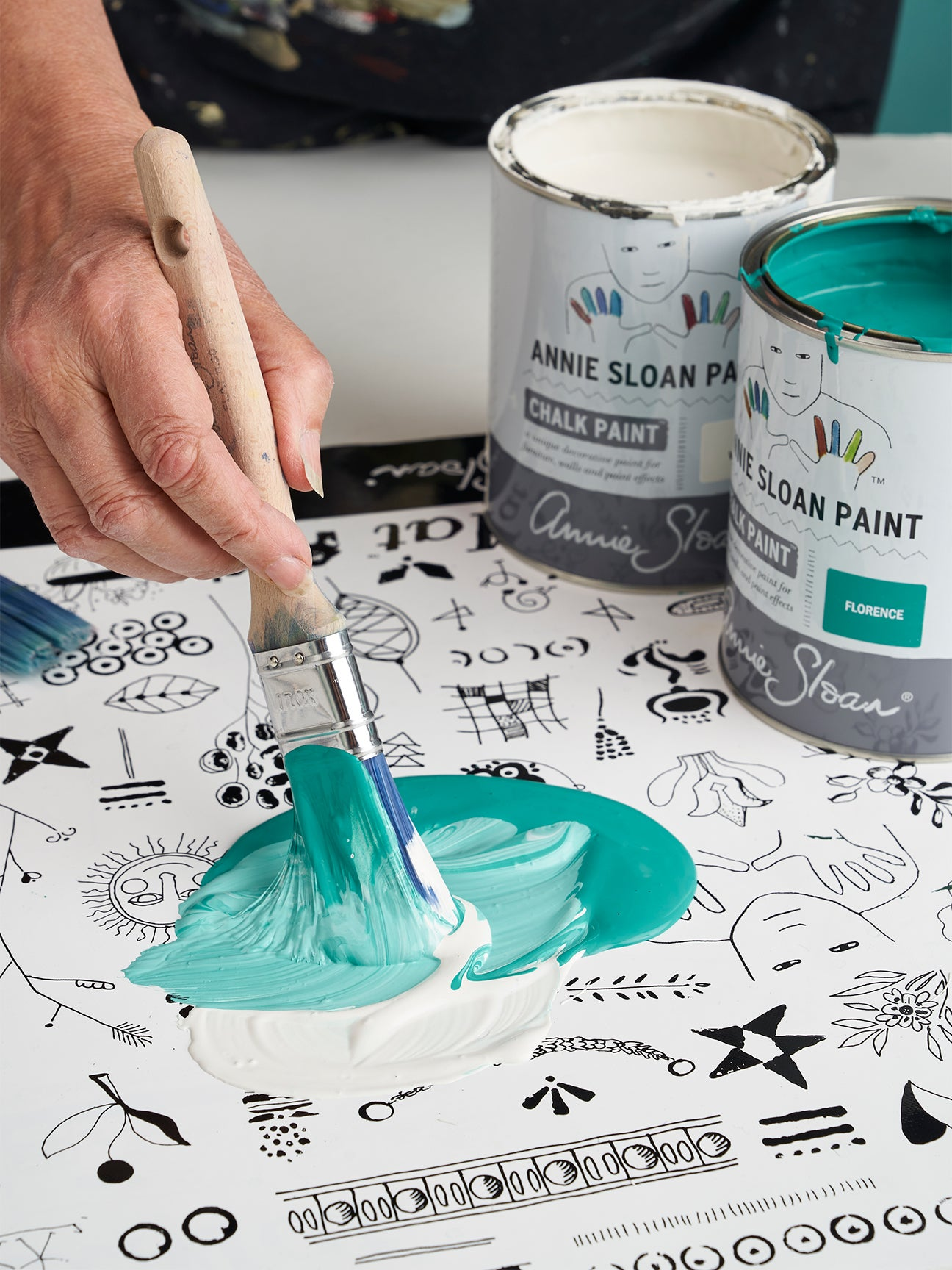 person mixing paint colors