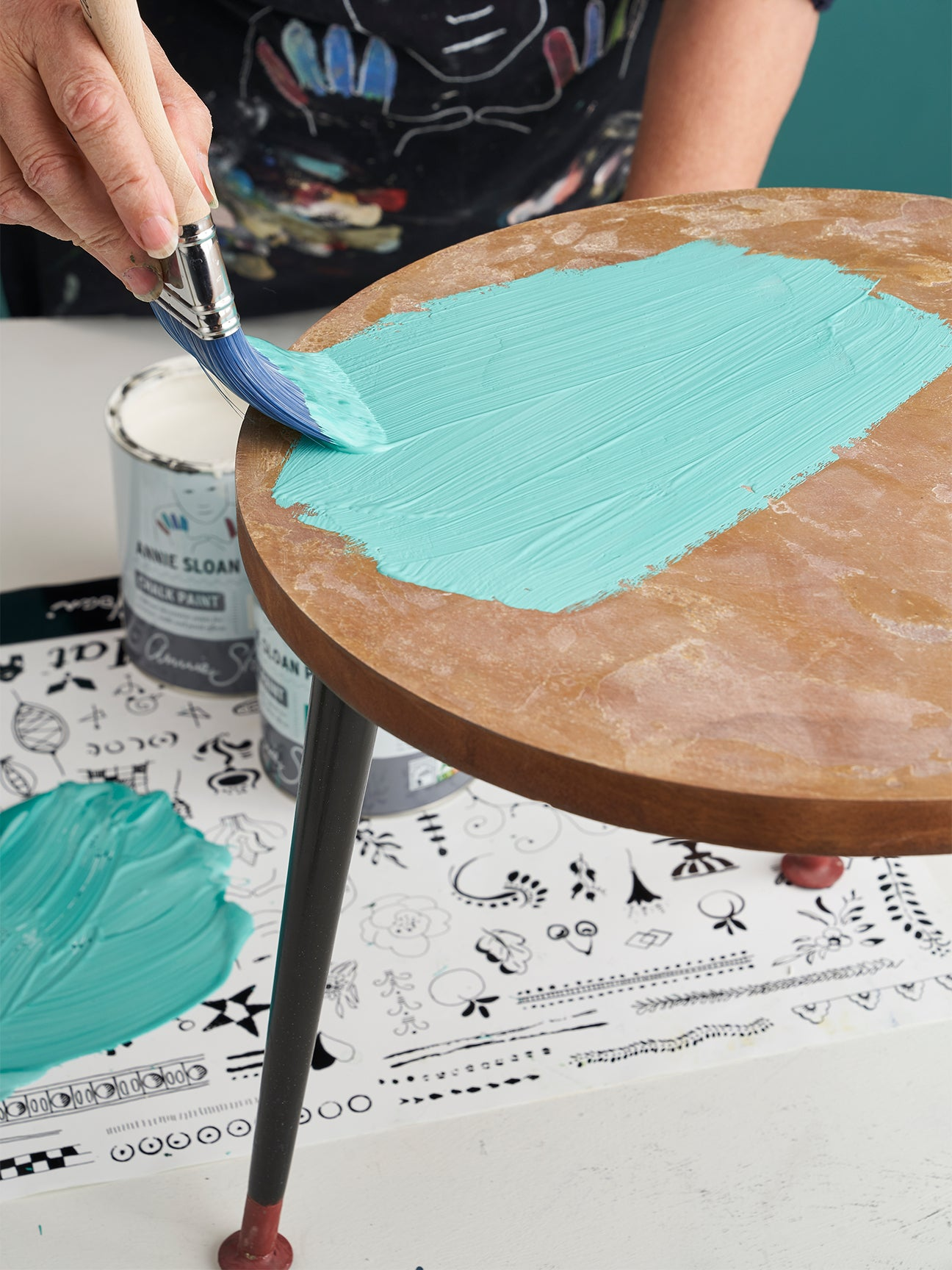 painting blue color on a wood table