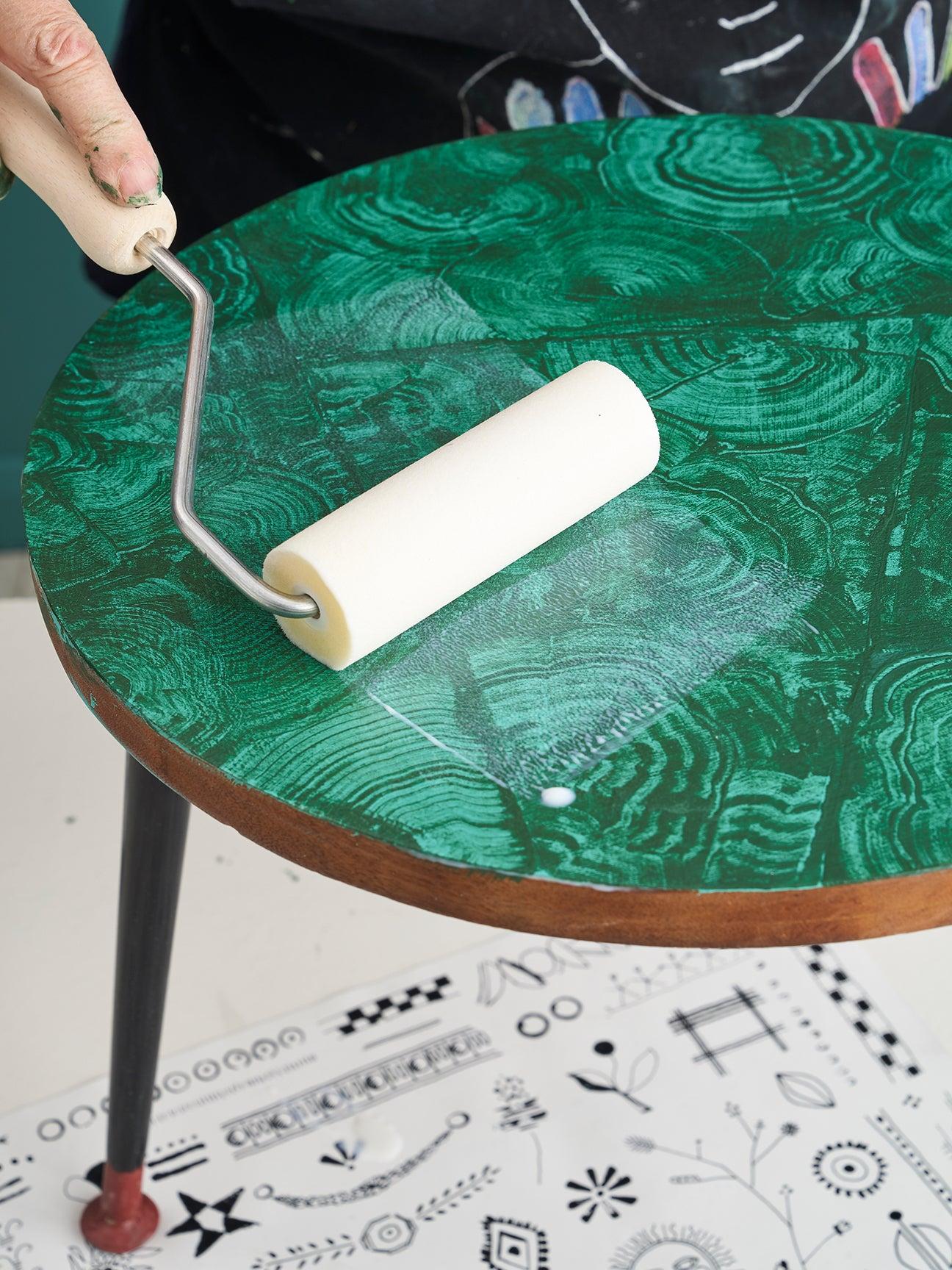 sponge roller going across a table