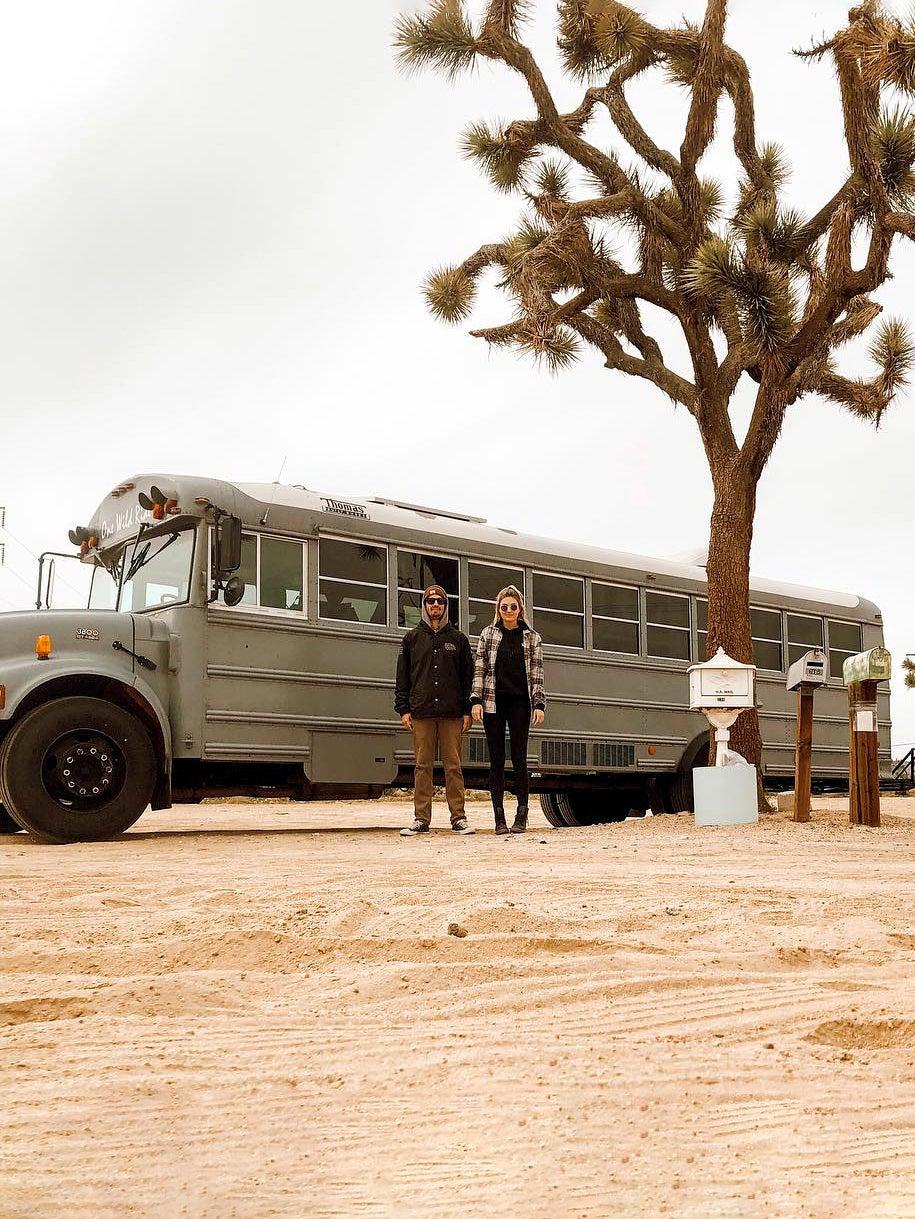 Couple in front of school bus