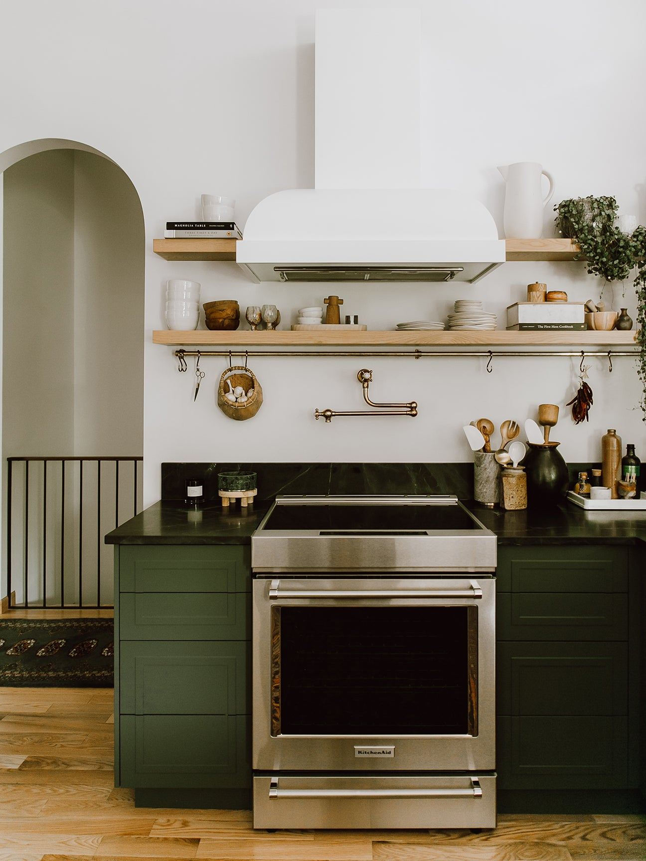 dark green kitchen with white hood
