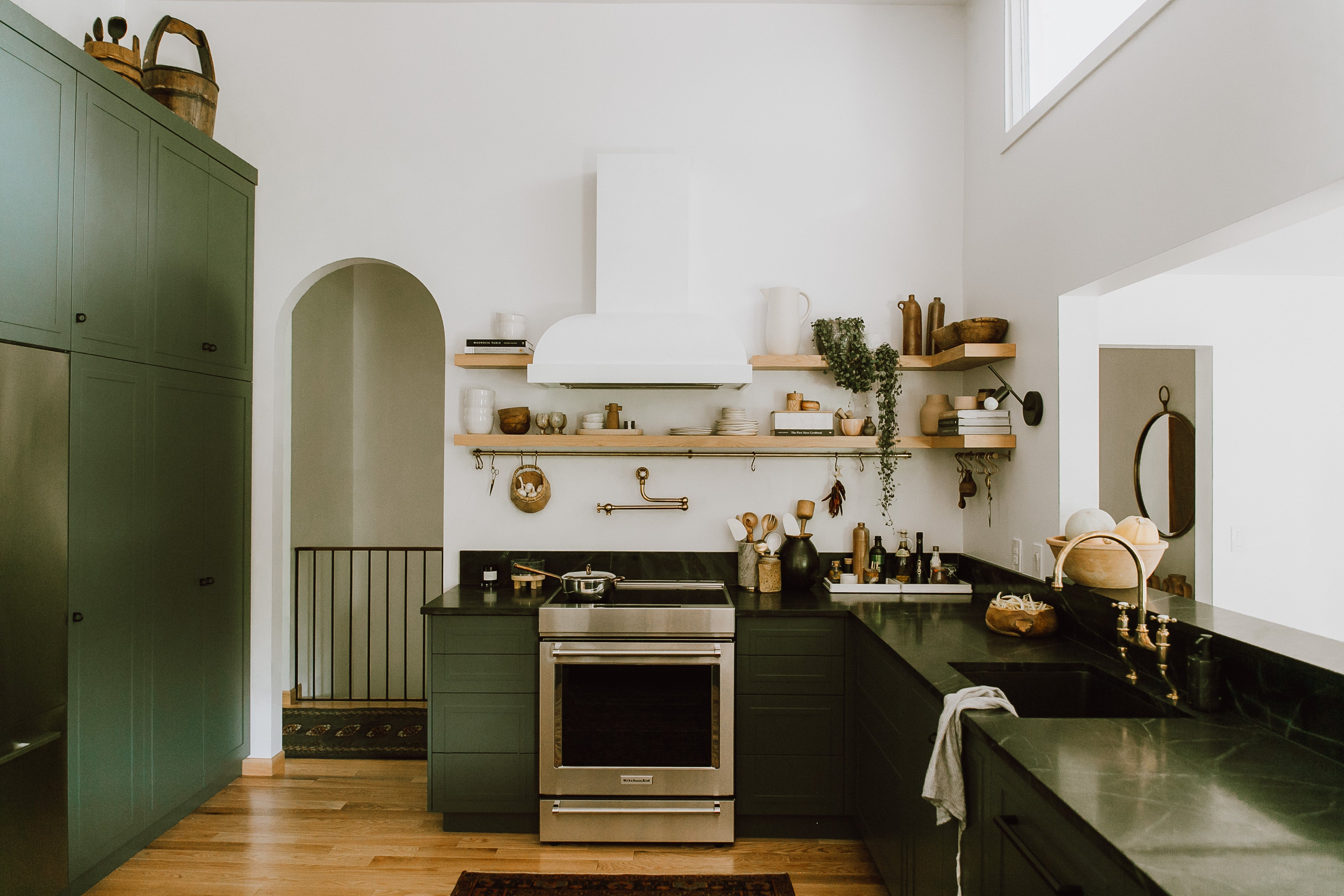 dark green kitchen with white hood