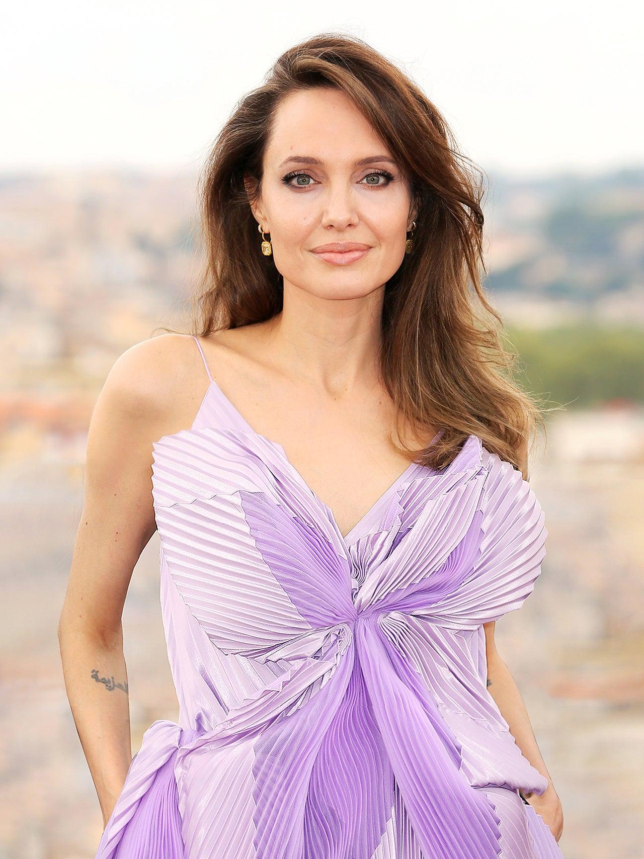 angelina jolie in a purple dress