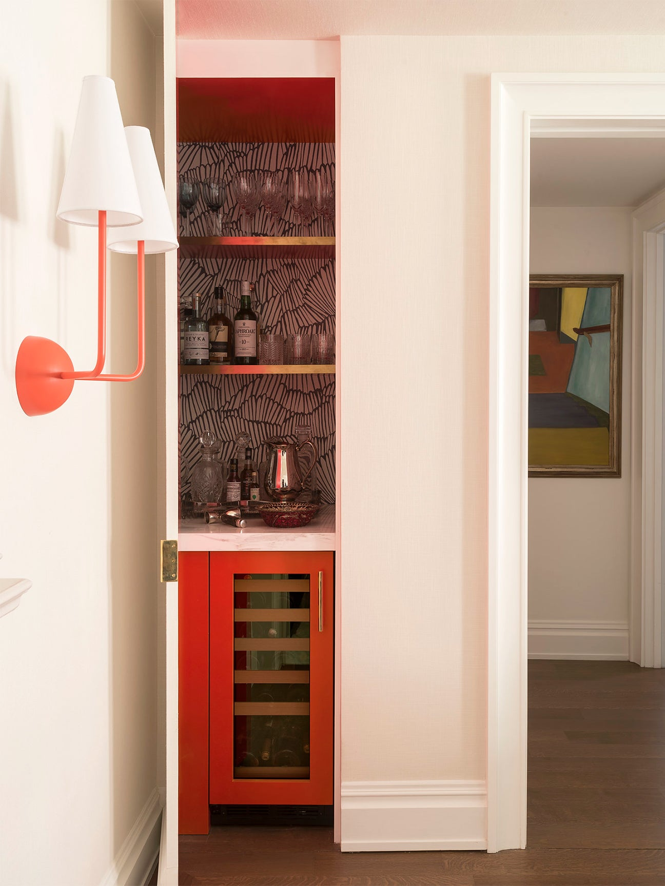 Red wet bar in closet by Studio DB