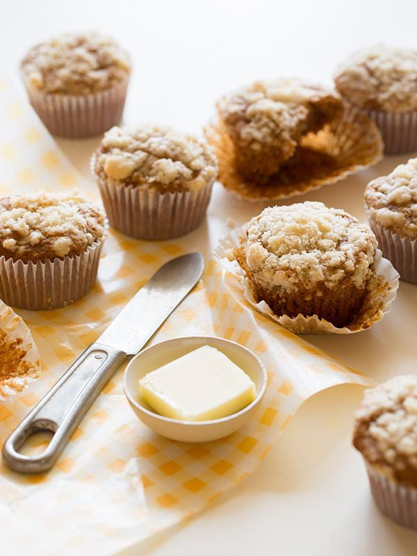 Acorn squash muffins with butter.