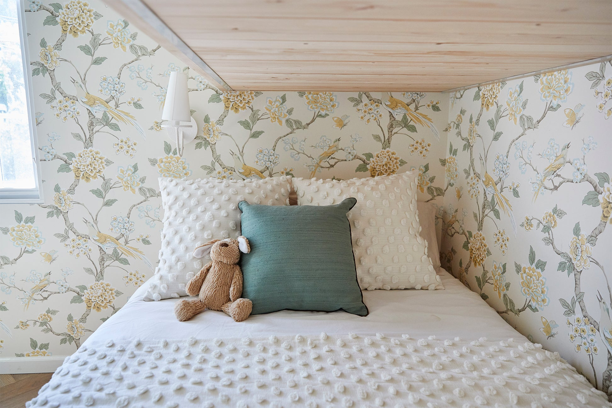 kids bed with floral wallpaper