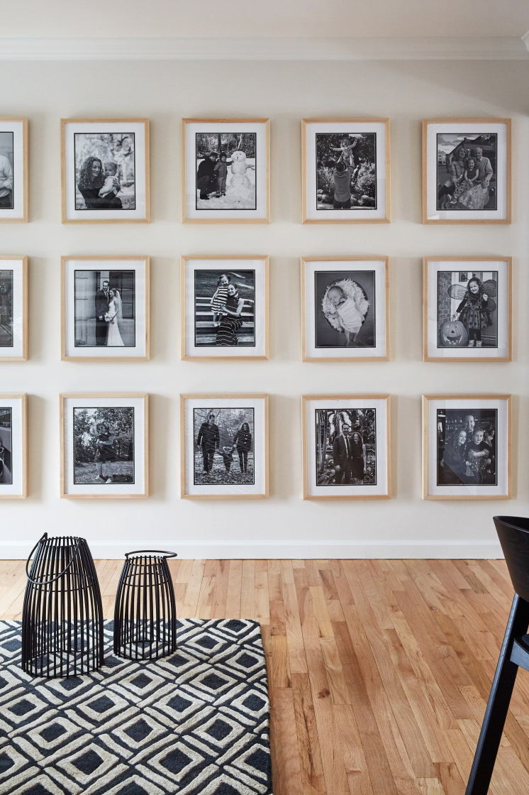 black and white family photo gallery wall