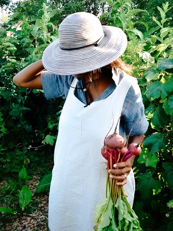 Woman holding freshly picked radishes